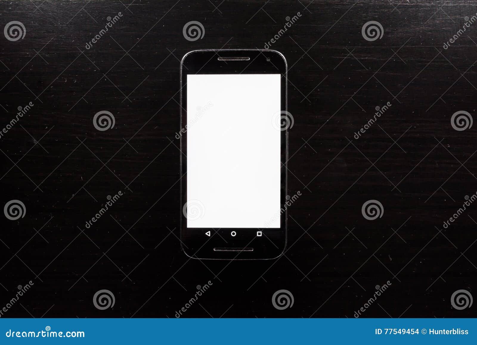 Bureau blanc vide en bois de noir d android de téléphone portable