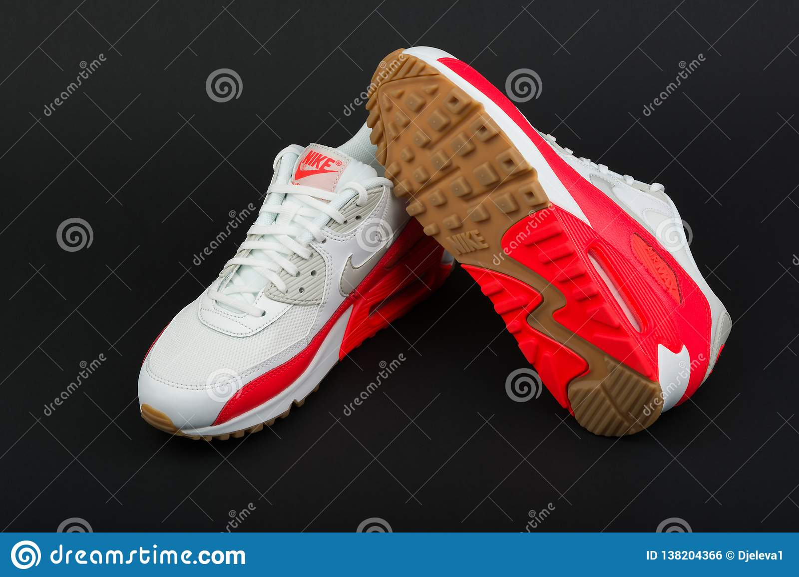 93362f3a BURGAS, BULGARIA - AUGUST 29, 2016: Nike Air MAX women`s shoes - sneakers -  trainers in white and orange on black background. Editorial Stock Photo