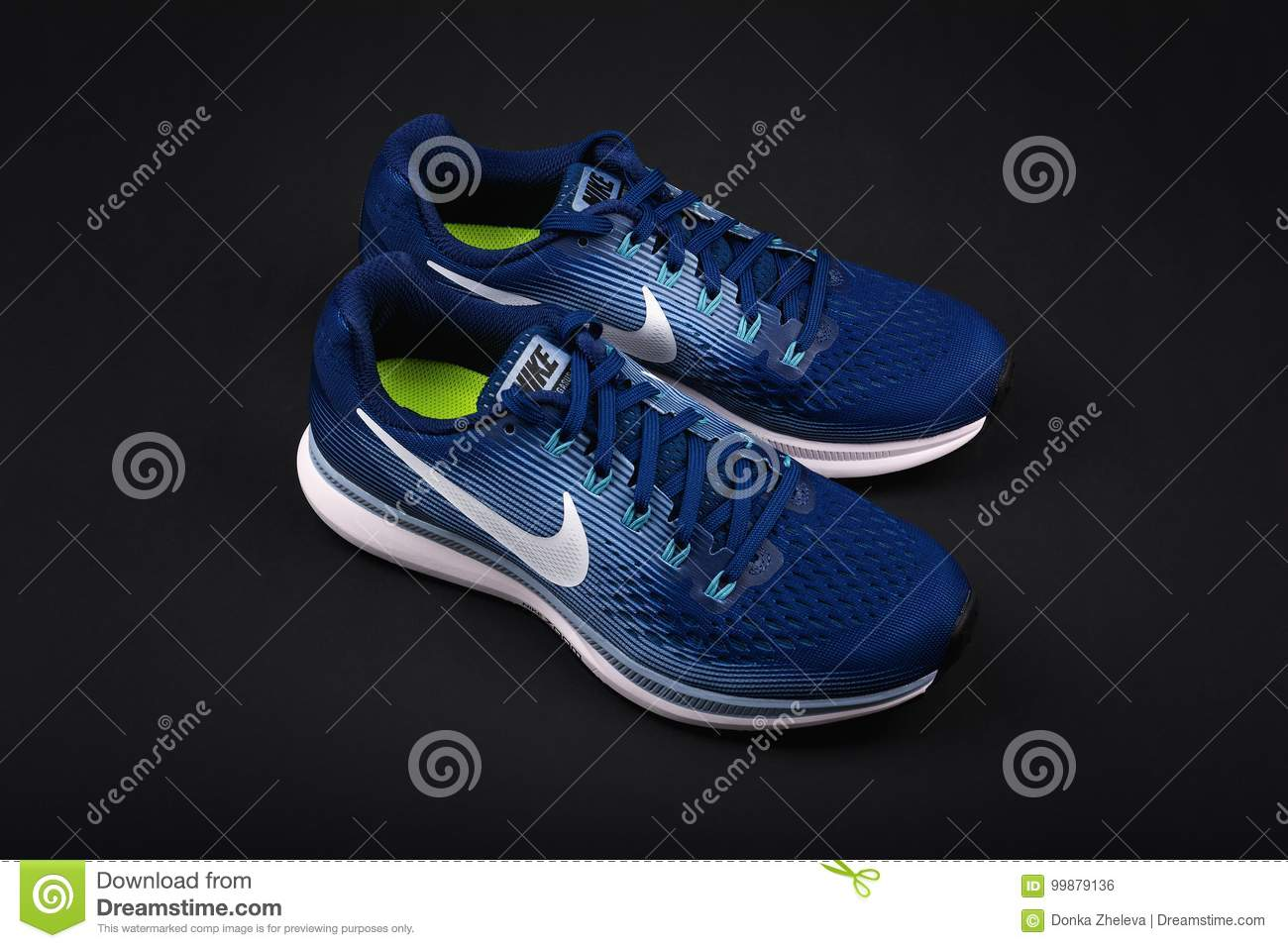 725c530a BURGAS, BULGARIA - SEPTEMBER 6, 2017: Nike Air Zoom Pegasus 34 Women`s  Running Shoes in blue on black background. Editorial Stock Photo