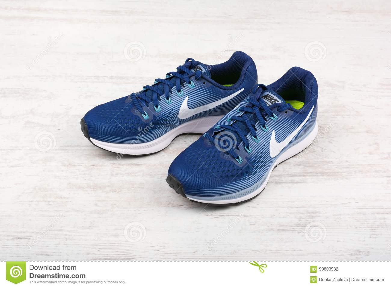 252d8899 BURGAS, BULGARIA - SEPTEMBER 6, 2017: Nike Air Zoom Pegasus 34 Women`s  Running Shoes in blue on white wooden background. Nike is a global sports  clothes and ...