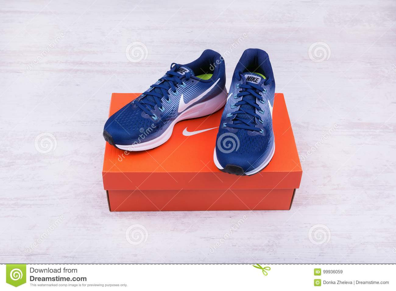 d9c5c742 BURGAS, BULGARIA - SEPTEMBER 6, 2017: Nike Air Zoom Pegasus 34 Women`s  Running Shoes in blue on white wooden background. Editorial Stock Photo