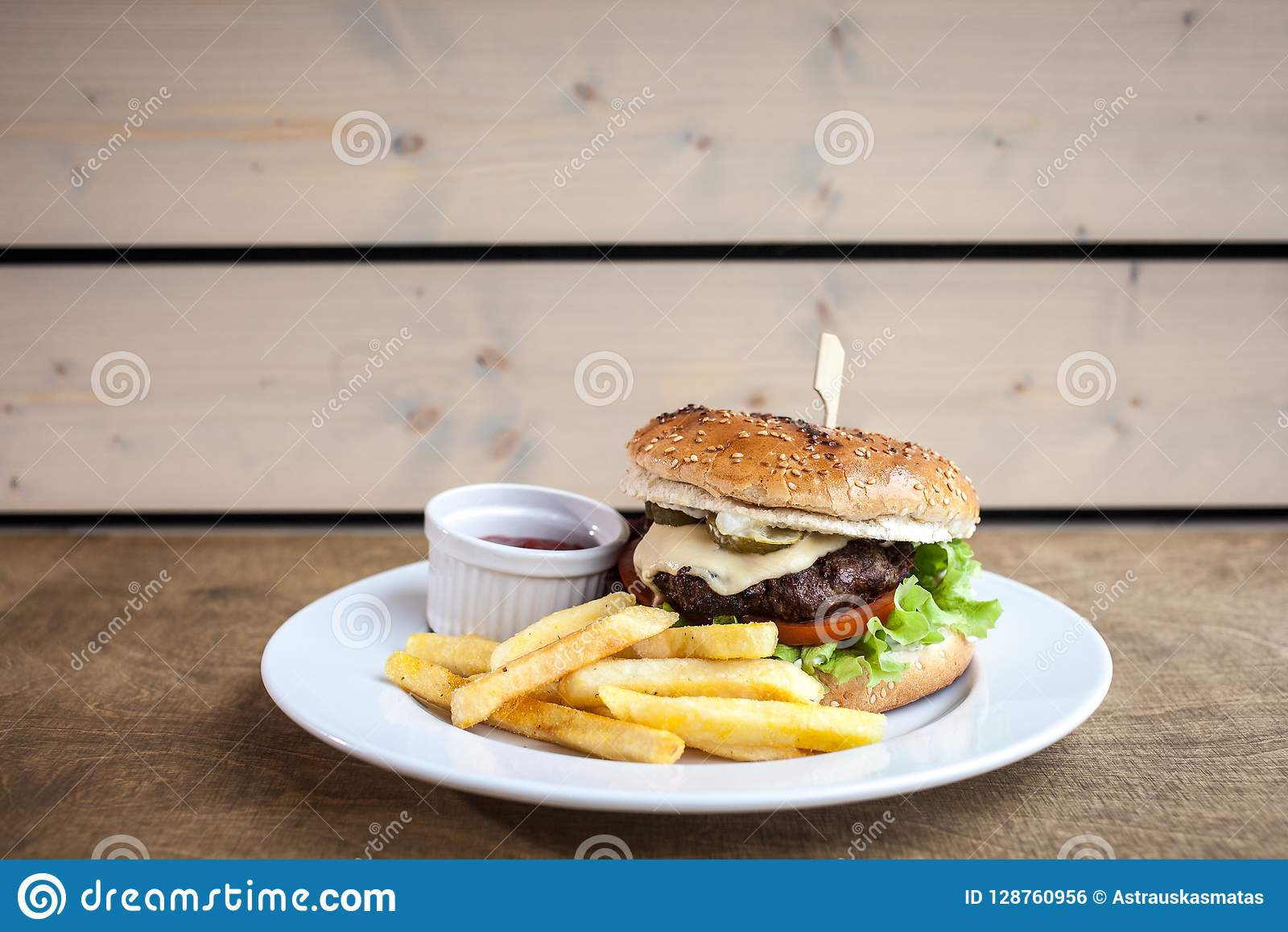 Burger With Cheese And A Fries And A Ketchup Stock Photo