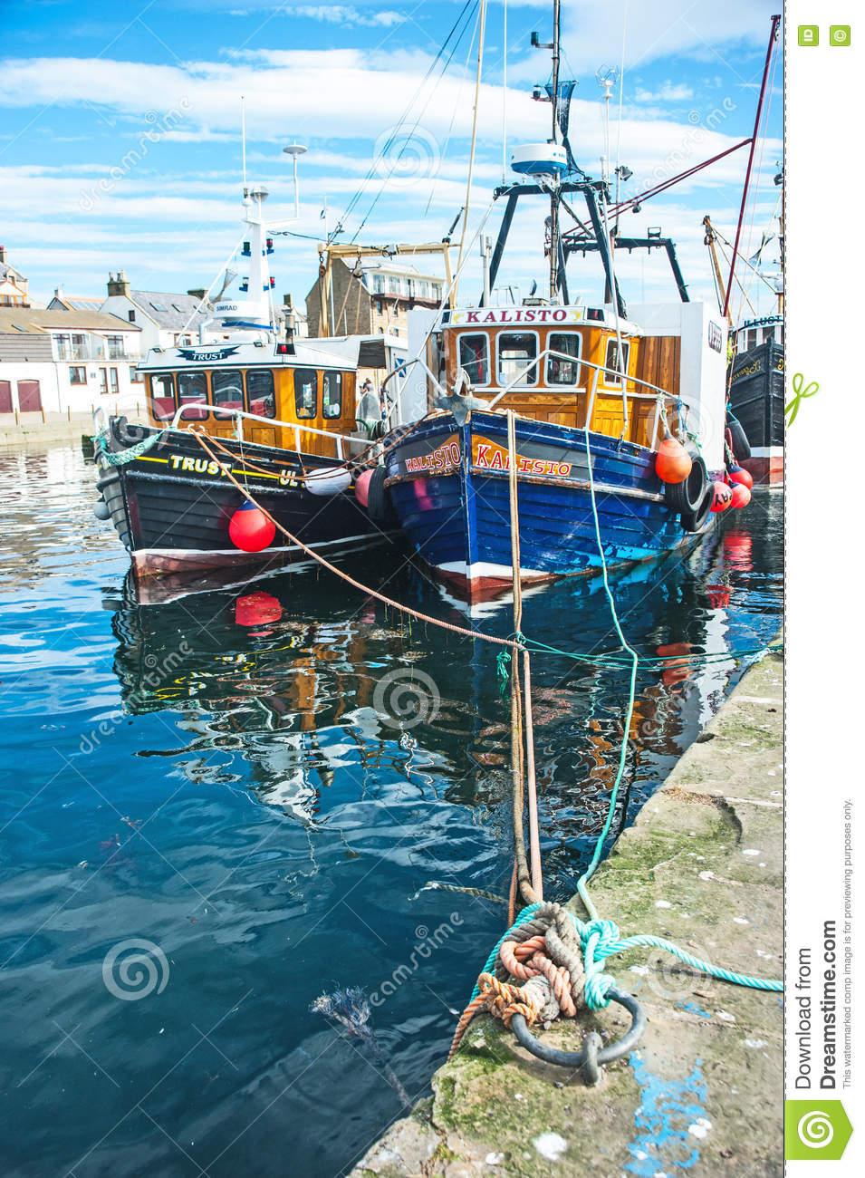 Burghead harbor with fishing boats editorial photo for East coast fishing