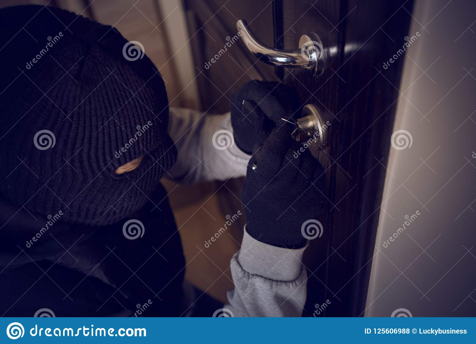 Burglar breaking into the lock