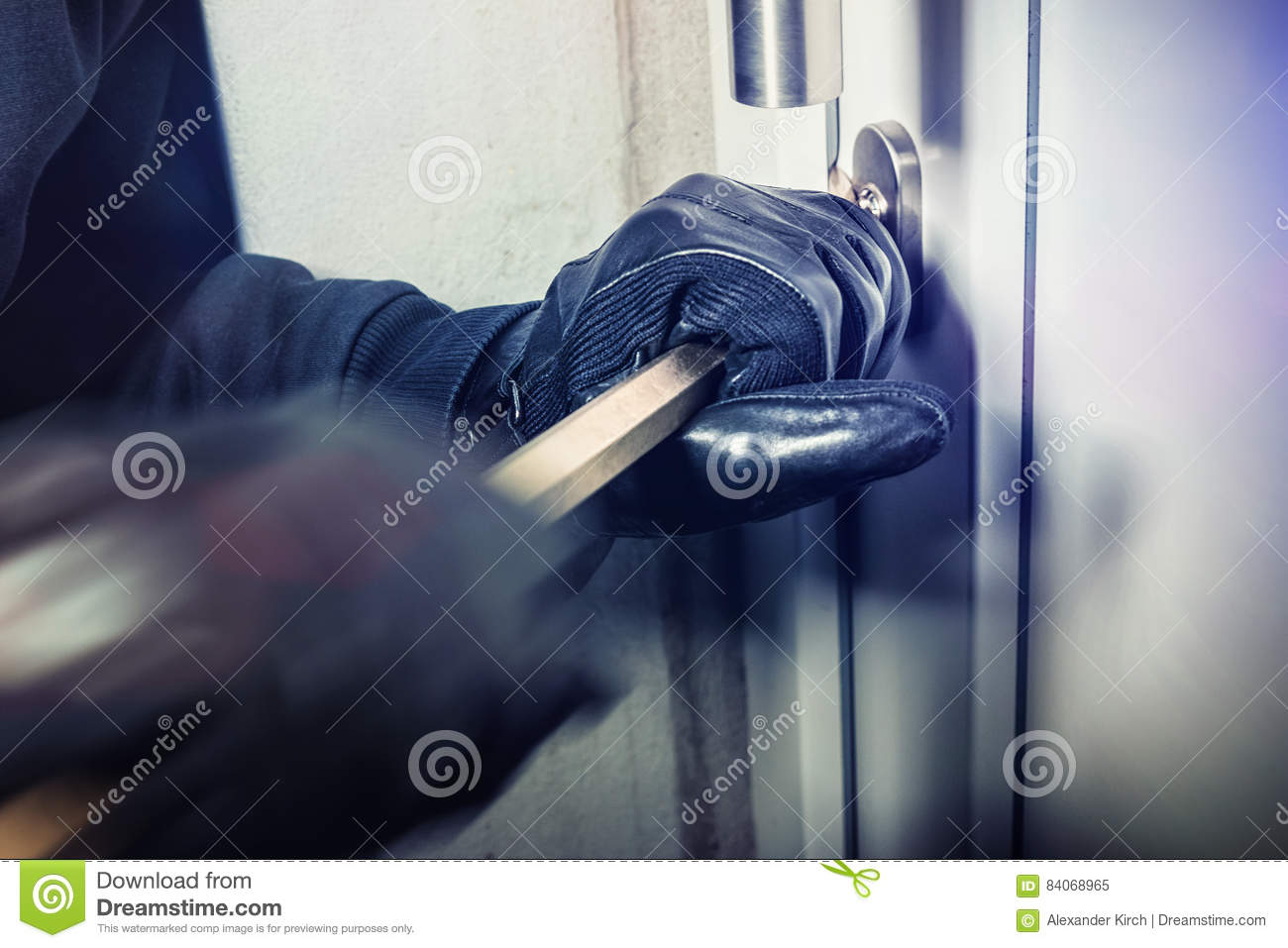 Burglar With Crowbar Break Door To Enter The House Stock