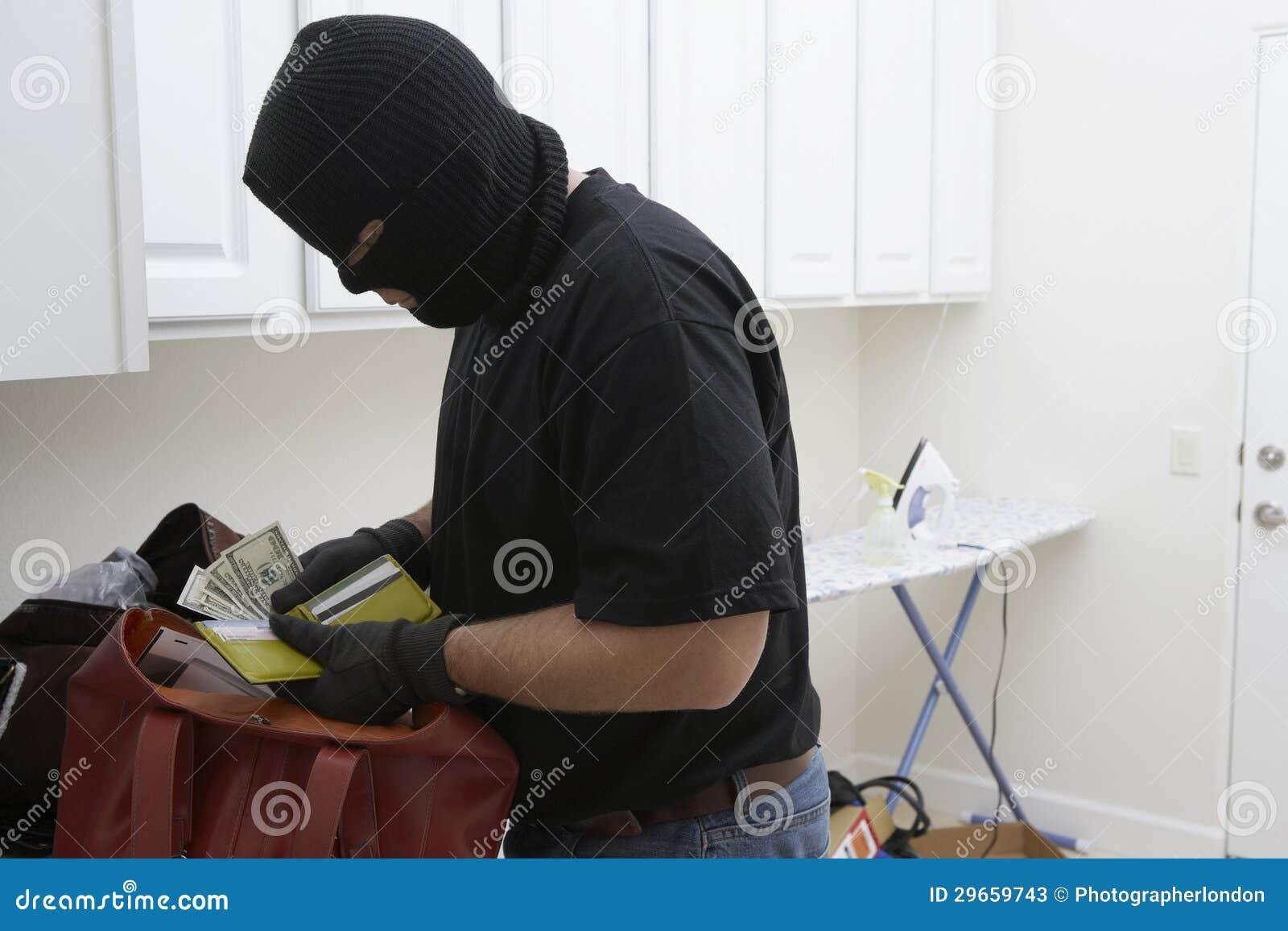 Burglar Stealing Money From House Stock Photos - Image ...