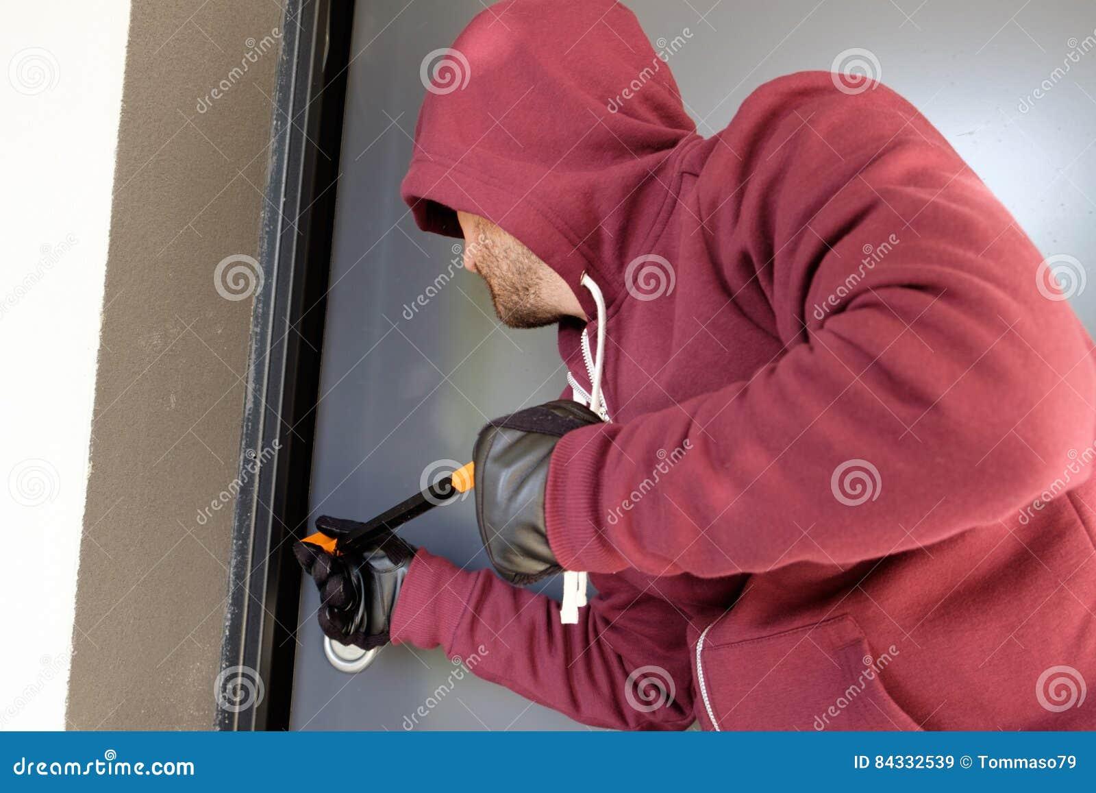 Burglar trying to force a door lock