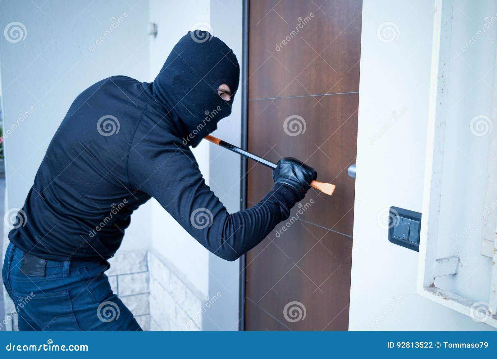 Burglar trying to force a door