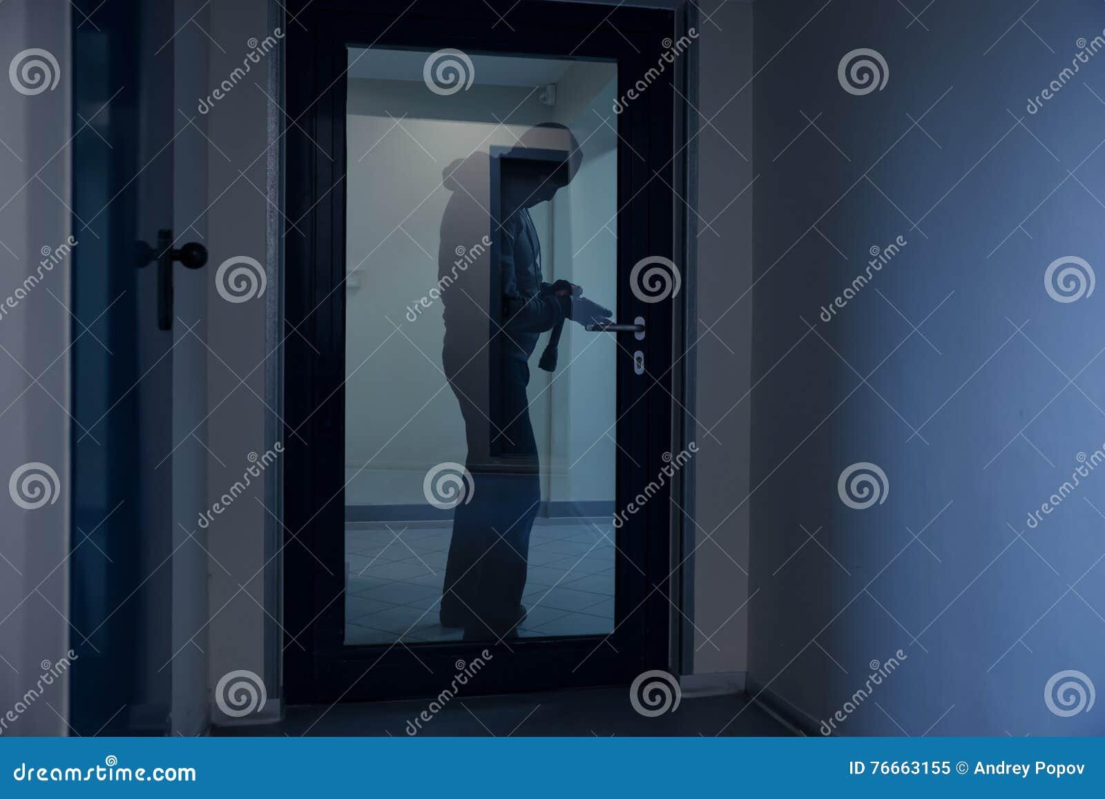 Burglar Using Crowbar To Open Glass Door Stock Image Image Of