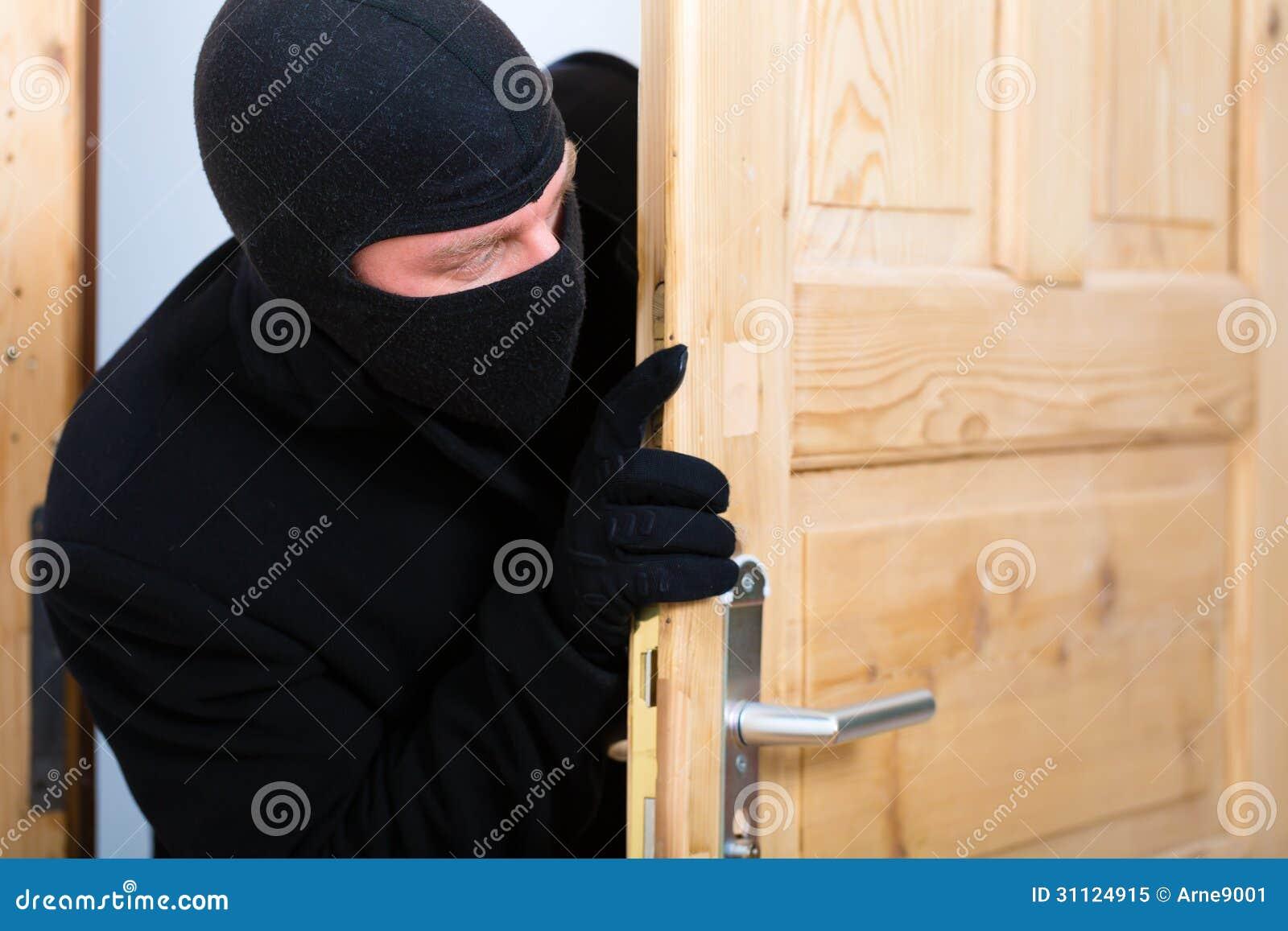 Burglary Crime Burglar Opening A Door Stock Image