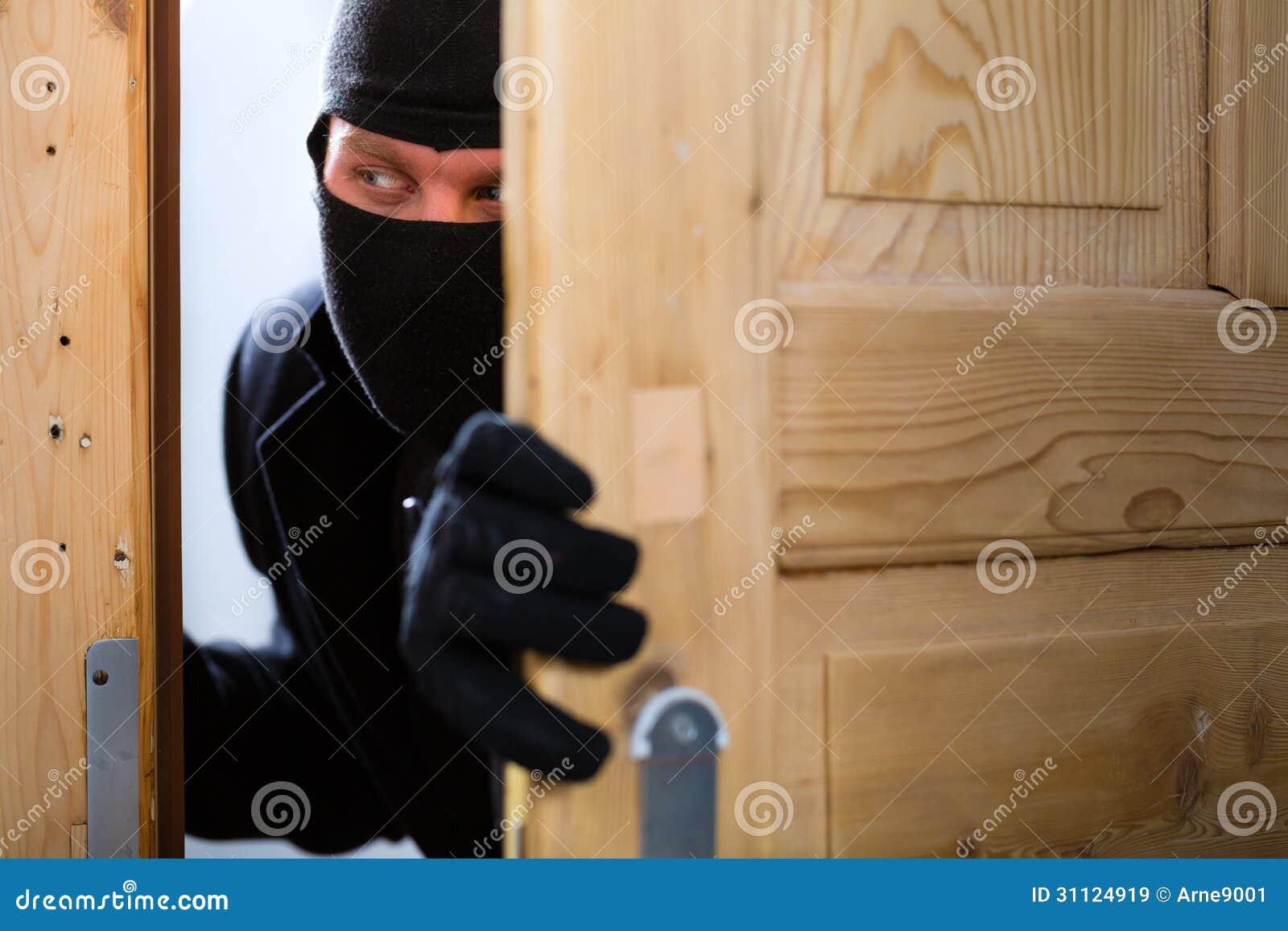 Burglary Crime Burglar Opening A Door Royalty Free Stock
