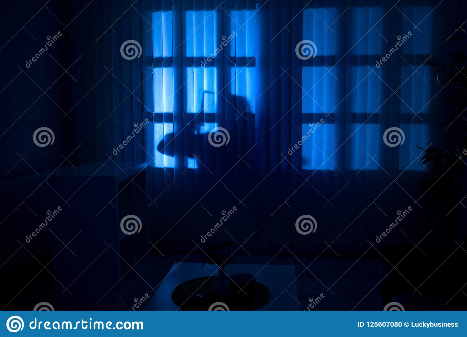 Burglary or thief breaking into a home at night