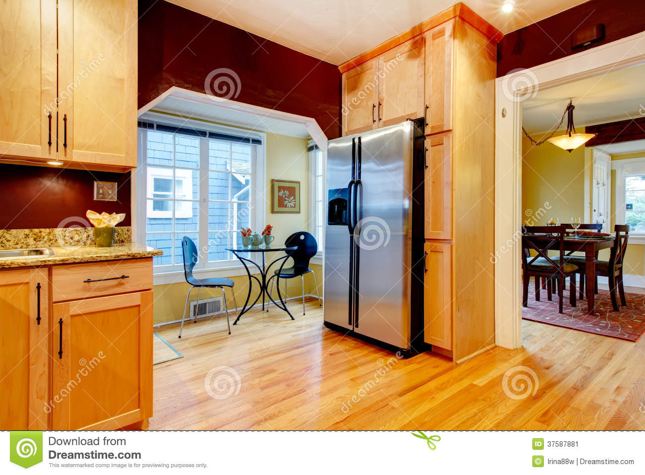 Perfect Burgundy Kitchen Room With Dining Area Stock Image