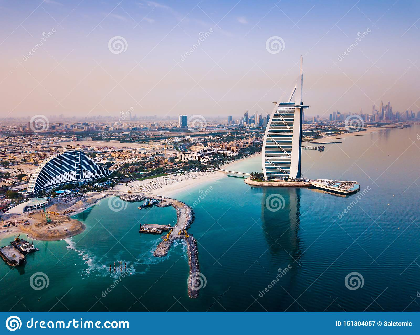 Burj Al Arab luxury hotel and Dubai marina skyline in the background
