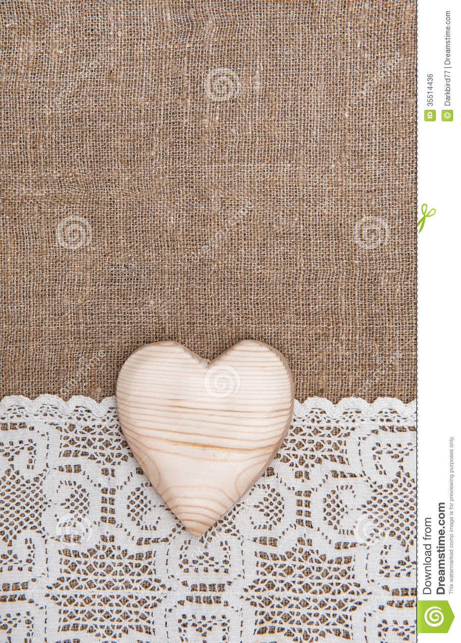 Burlap Background With Lacy Cloth And Wooden Heart Royalty Free Stock Photo