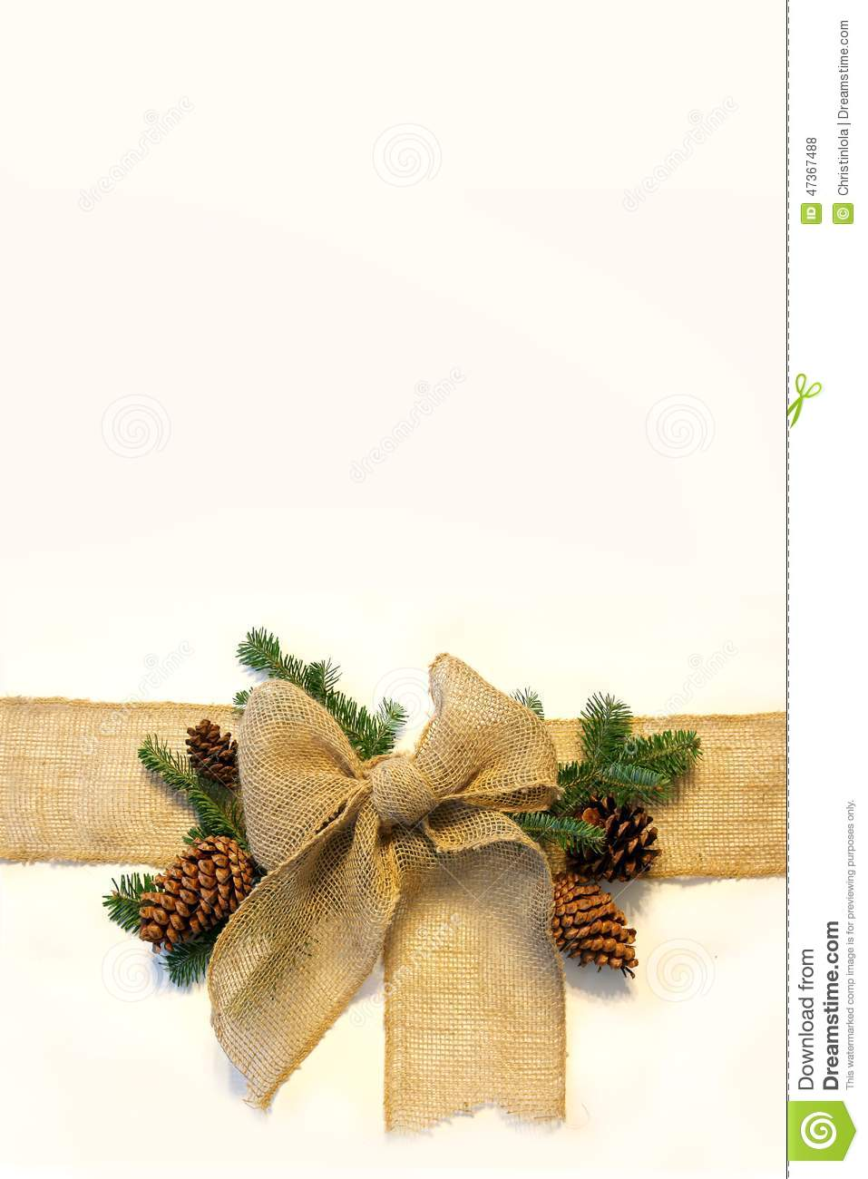 burlap christmas bow and pine cones frame on white