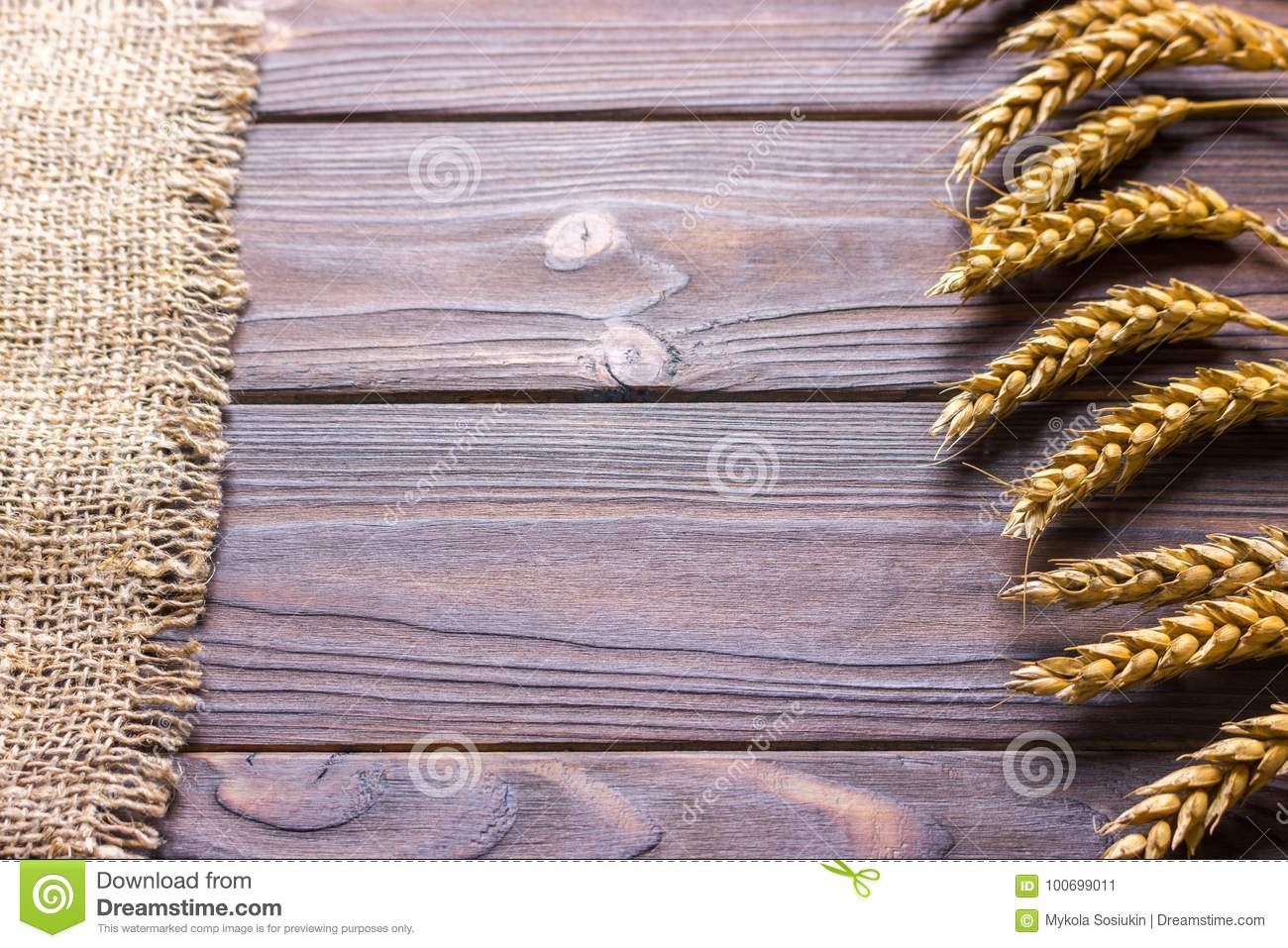 burlap hessian sacking on wooden background Harvest concept