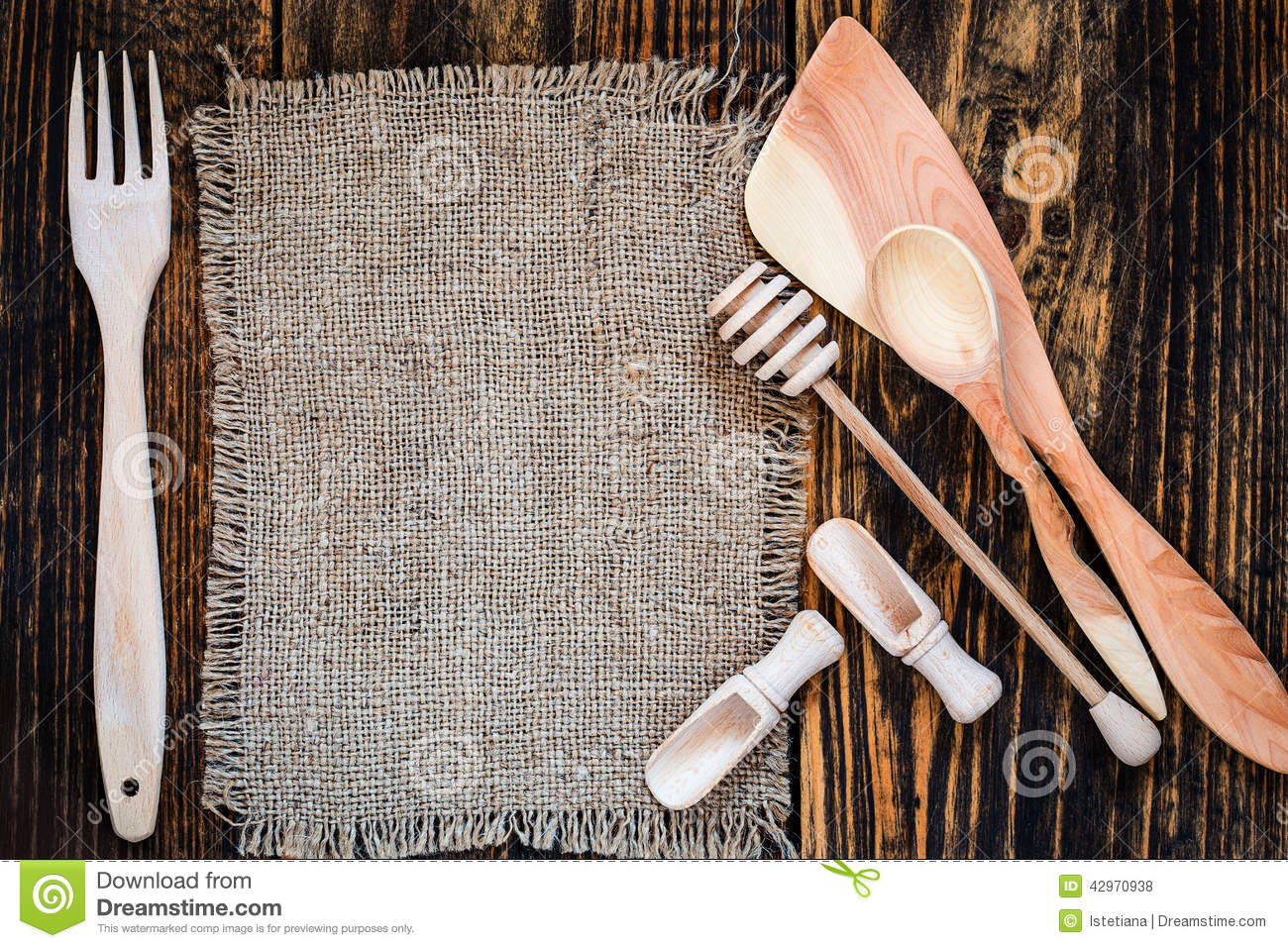 Burlap and rural kitchen utensils on wooden table view for Table utensils