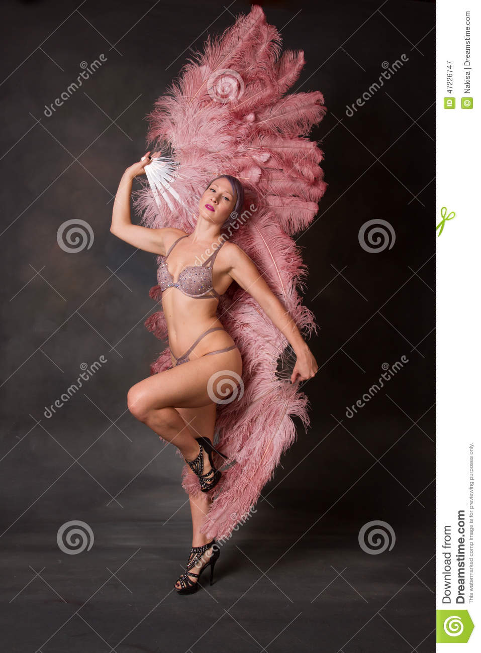 Burlesque dancer with feather fans