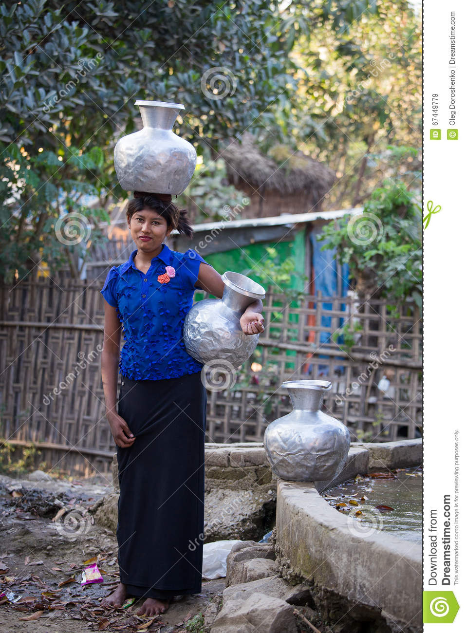 burmese girl with big jugs with water. mrauk u, myanmar editorial