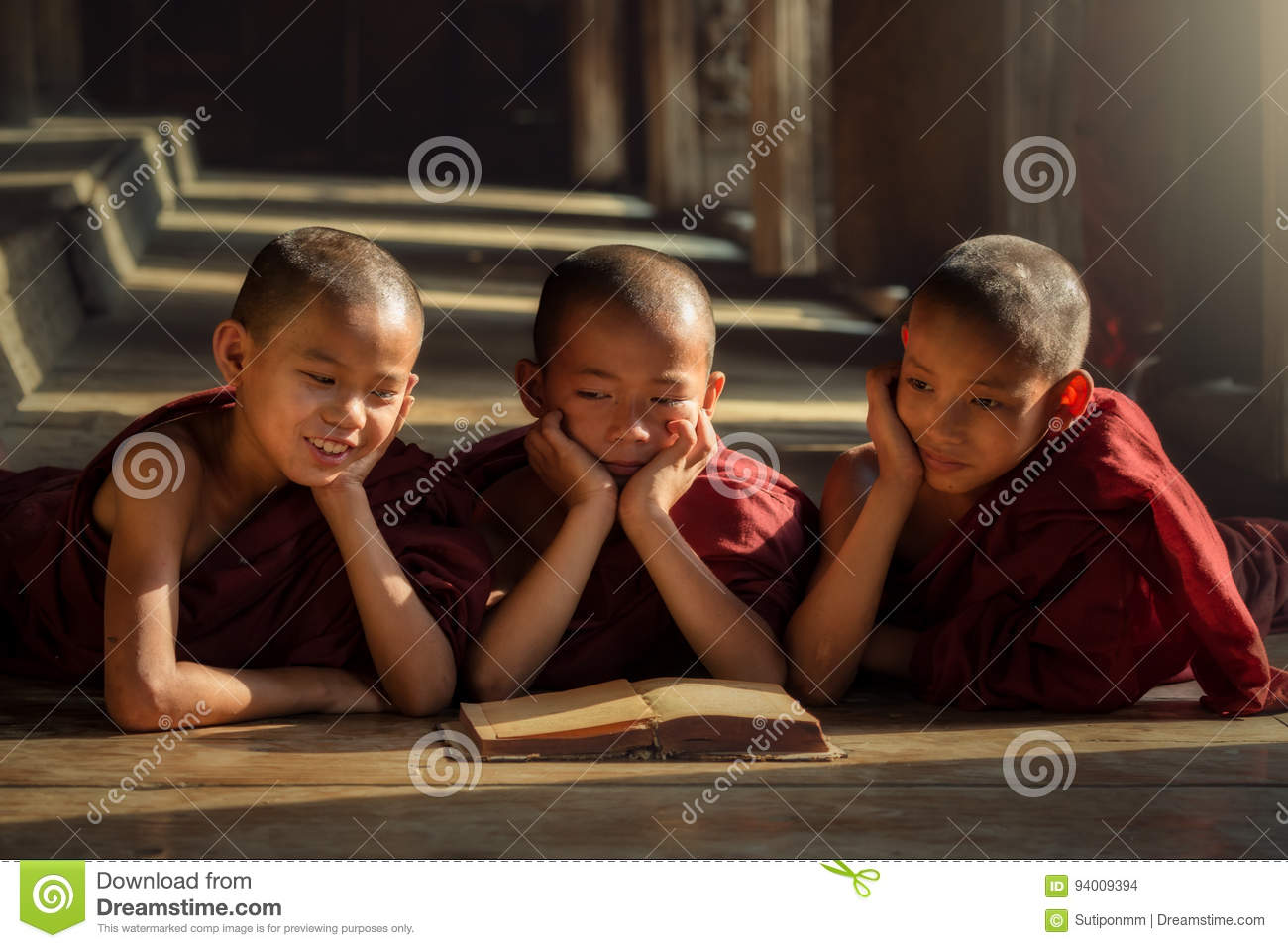 Burmese novices or three priests are reading happily in the classroom. Counting the development of education in Mandalay Myanmar
