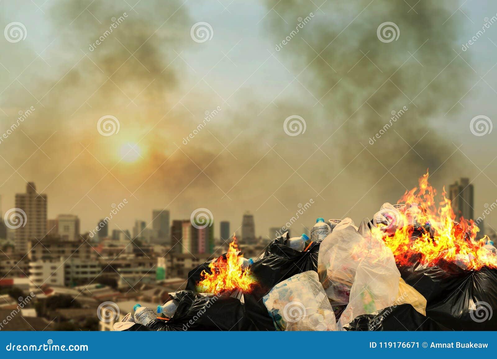 Burn lot waste front City community, Garbage bin pile Dump Lots of junk Polluting Burning heap smoke from burning pile garbage