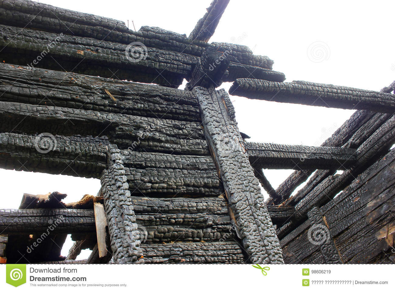 Burned Down Wooden House  Charred Walls  Burnt Roof Stock Image