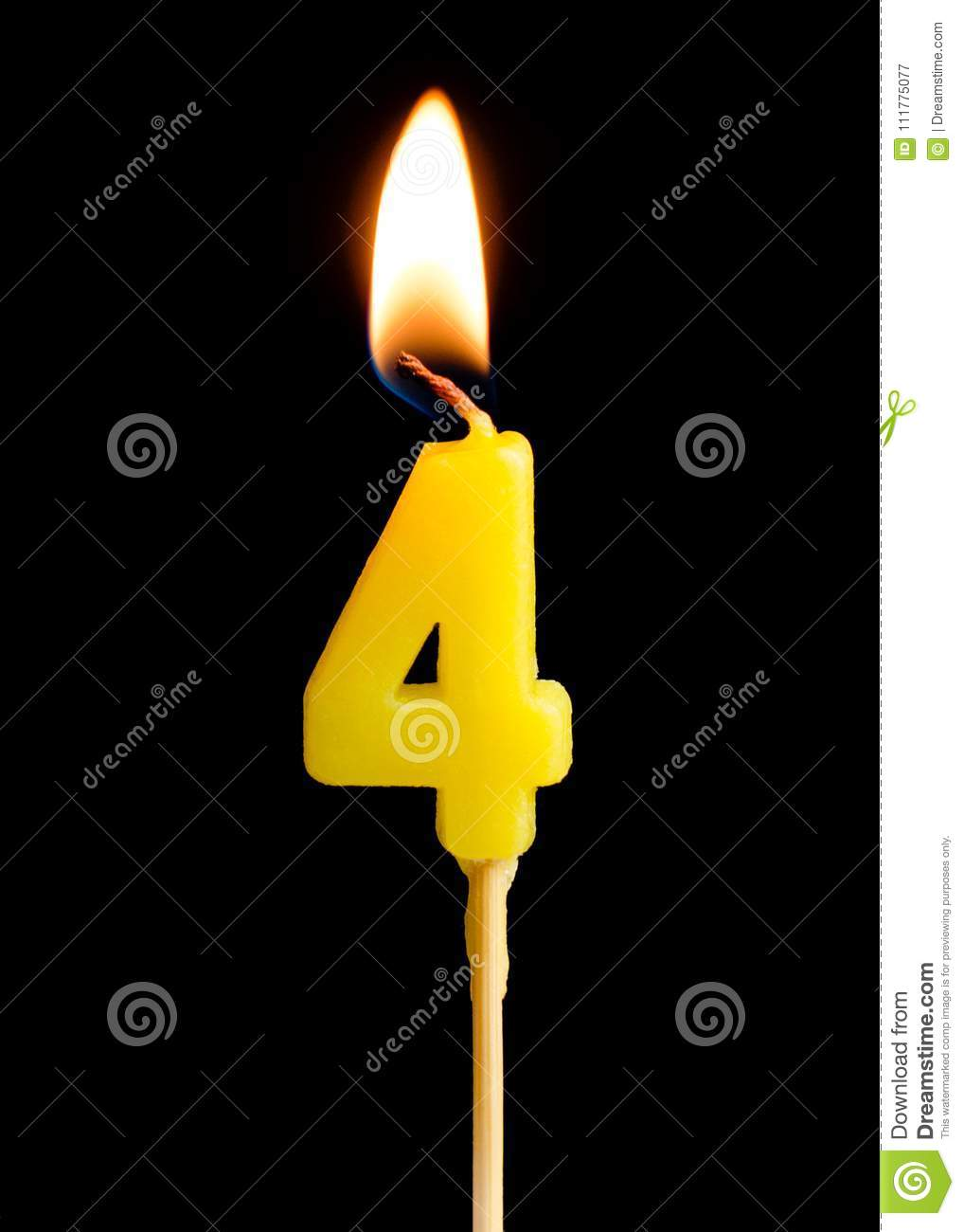 Burning candle in the form of four figures numbers, dates for cake isolated on black background.