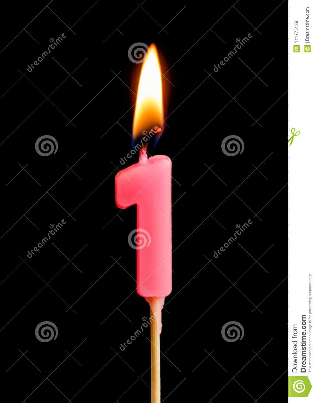Burning candle in the form of one figures numbers, dates for cake isolated on black background.