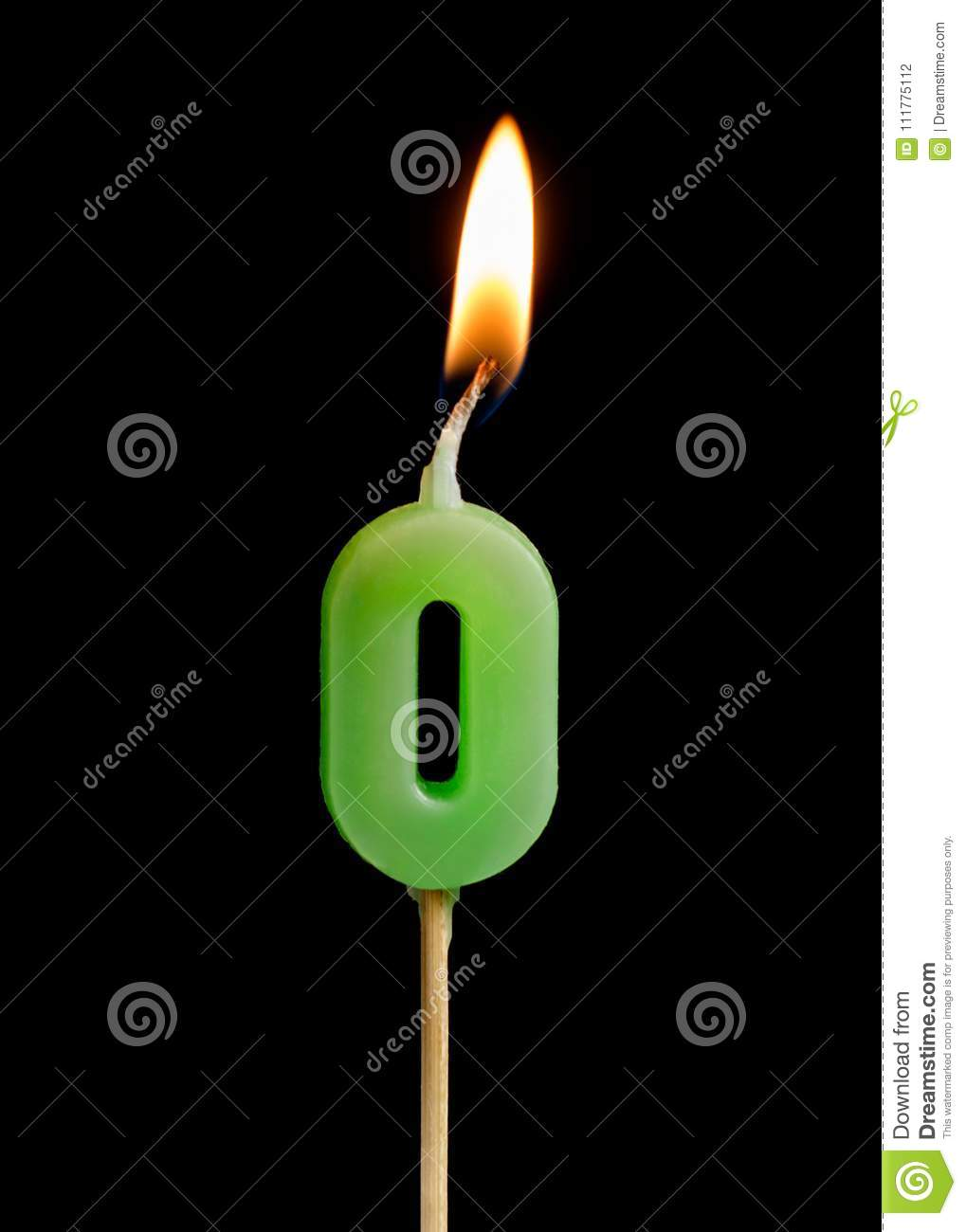 Burning candle in the form of zero figures numbers, dates for cake isolated on black background.