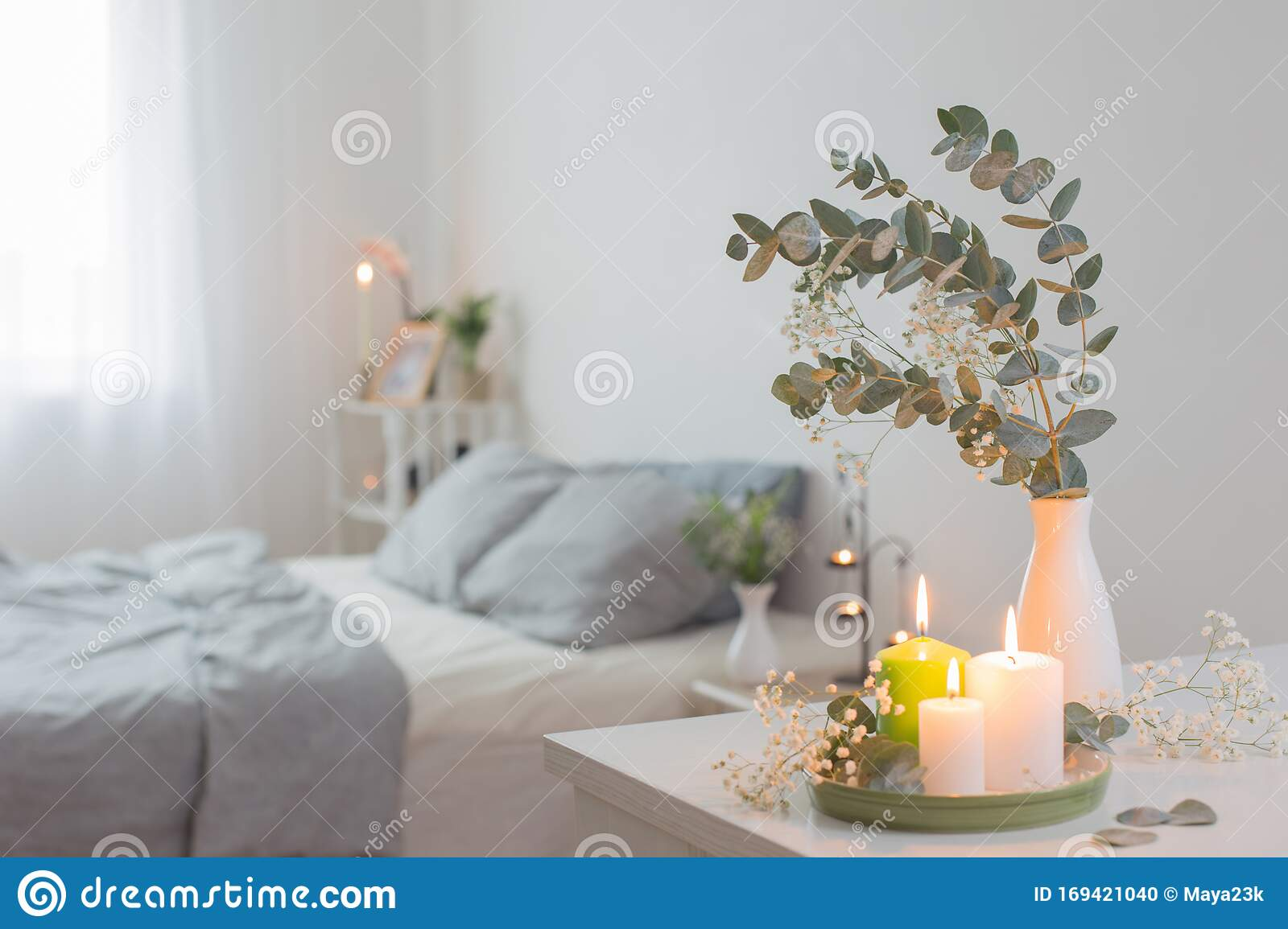 Candles And Eucalyptus In Vase In White Bedroom Stock Photo Image Of Decorate Cozy 169421040