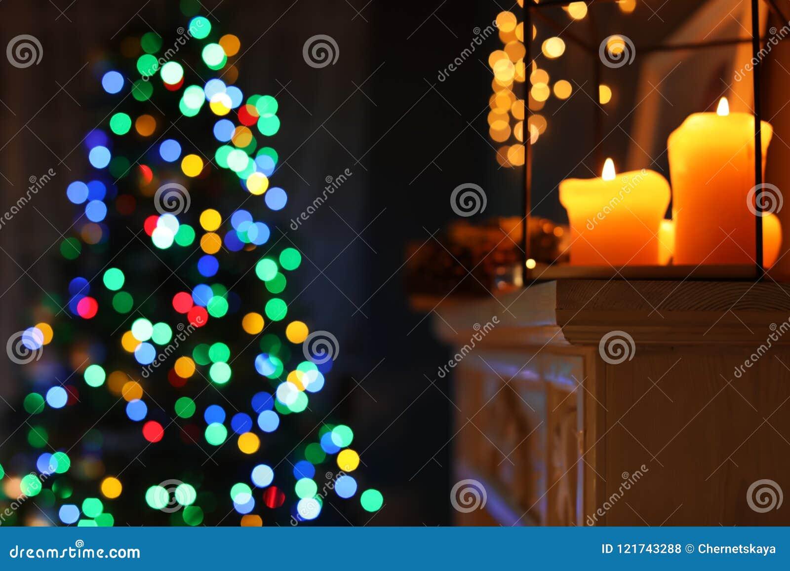Burning Christmas Tree.Burning Candles On Fireplace And Christmas Tree Stock Photo