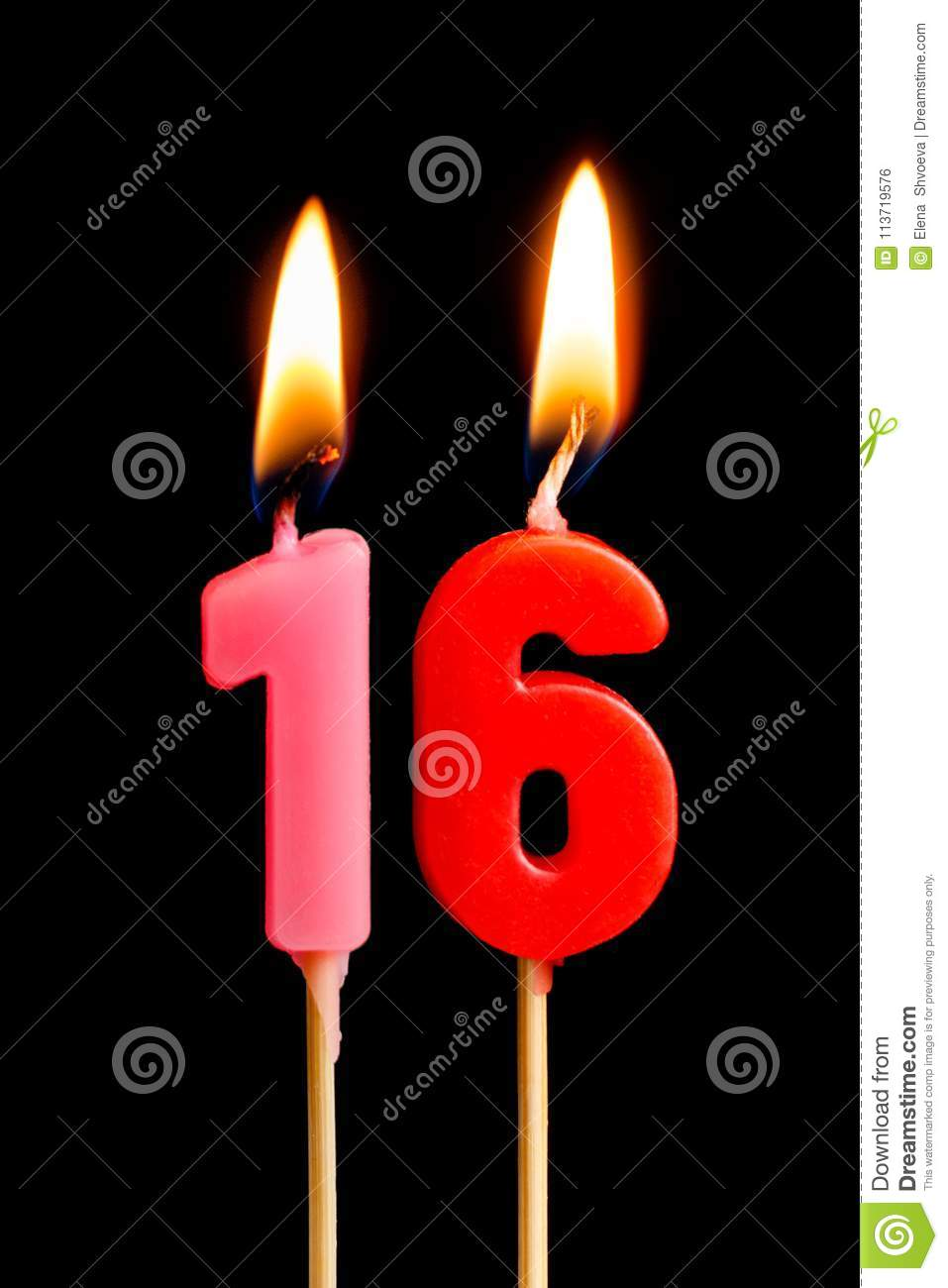 Burning candles in the form of 16 sixteen figures numbers, dates for cake isolated on black background. The concept of celebrati