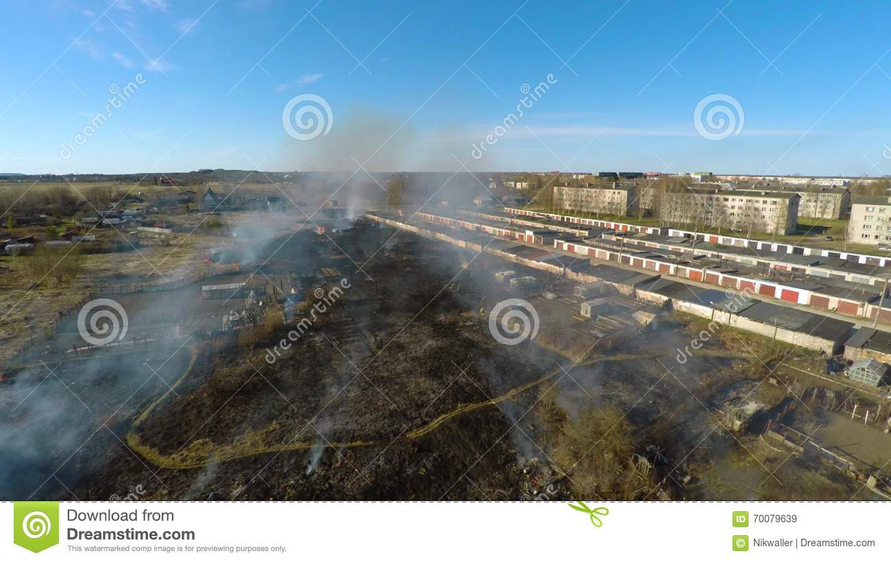 burning grass at backyard garages aerial footage stock video