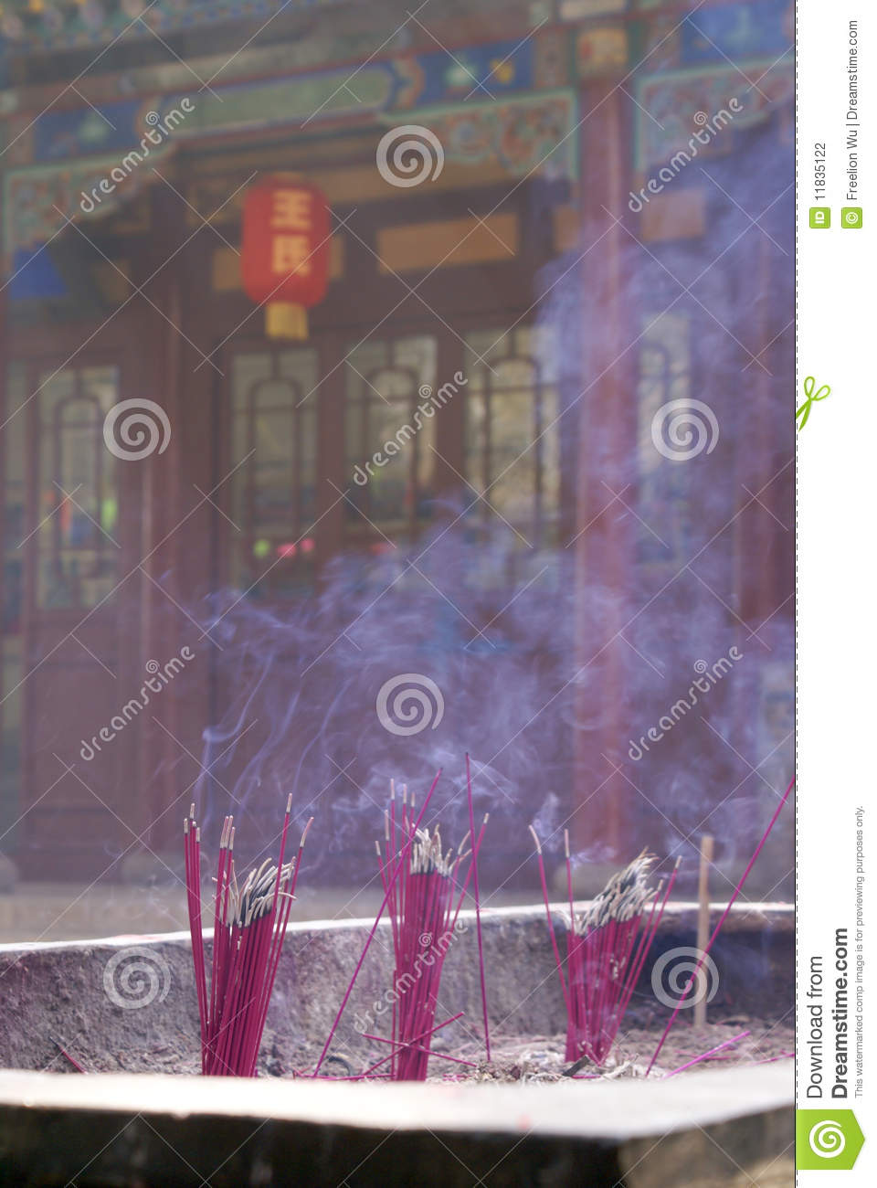 Burning incense sticks at a temple