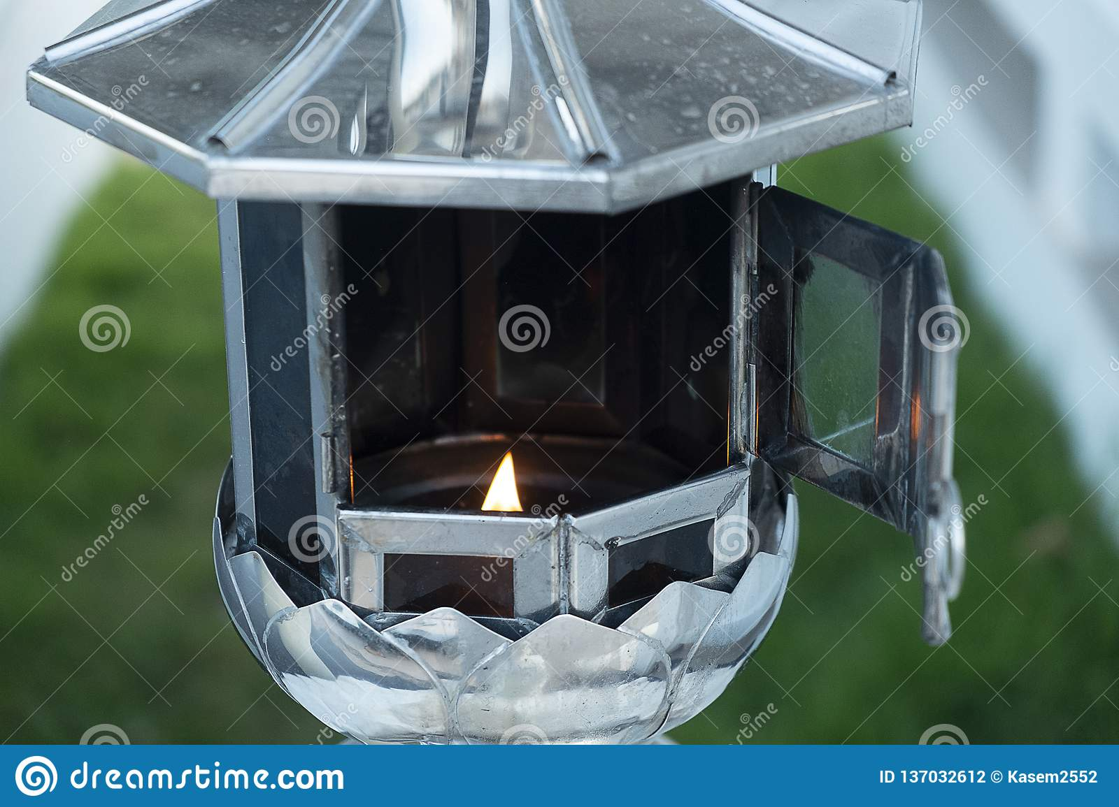 Burning lantern candles frame on the altar of Buddha in church or temple, Buddhists make merit