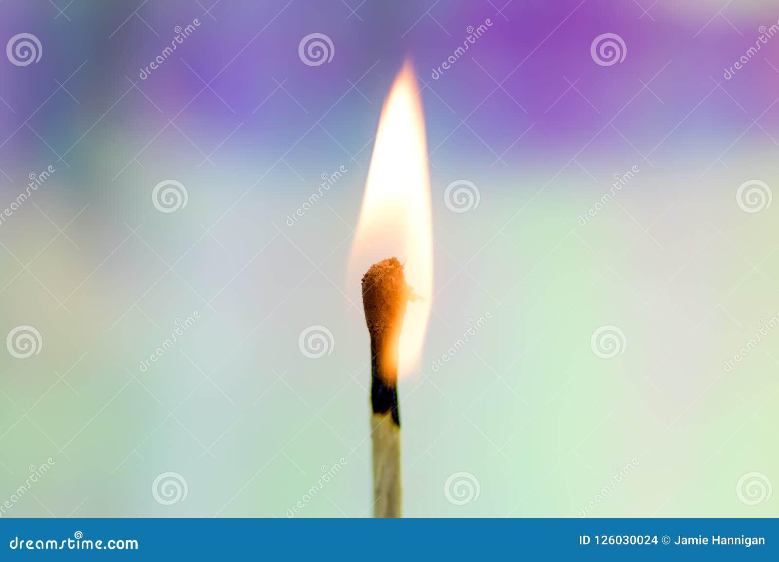 Burning Match with Rainbow Background