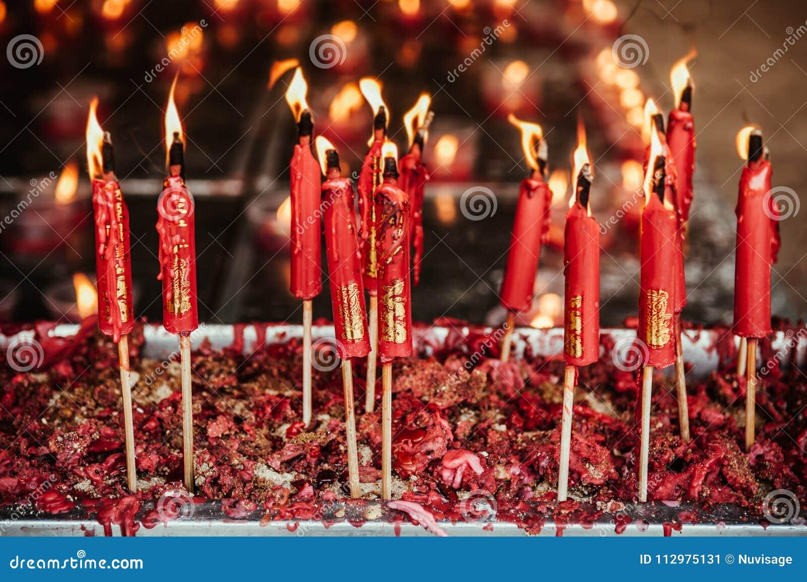Burning red chinese candle at Wat Mangkon Kamalawat famous Chine