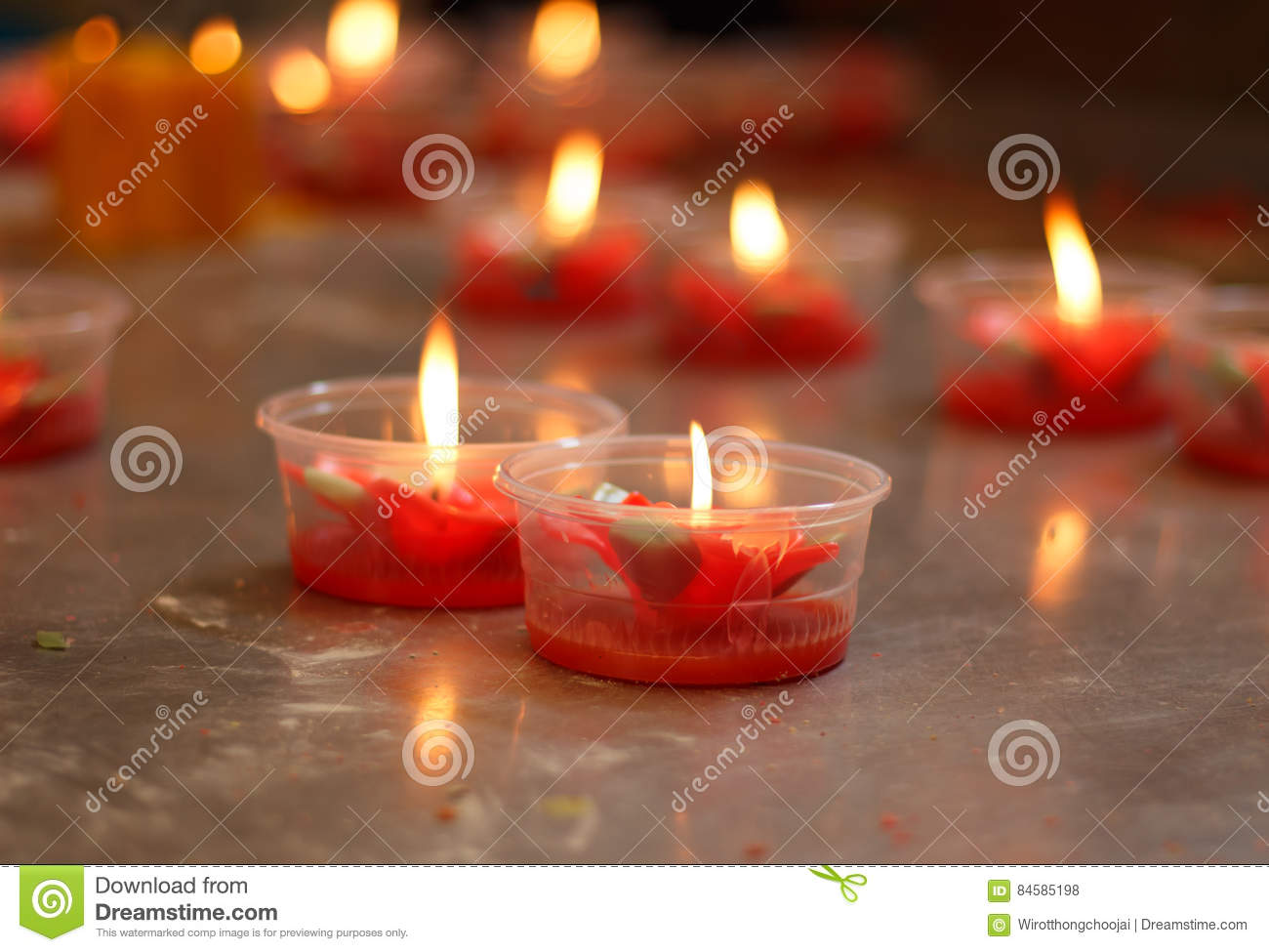 Burning red flower candle at chinese shrine for making merit in