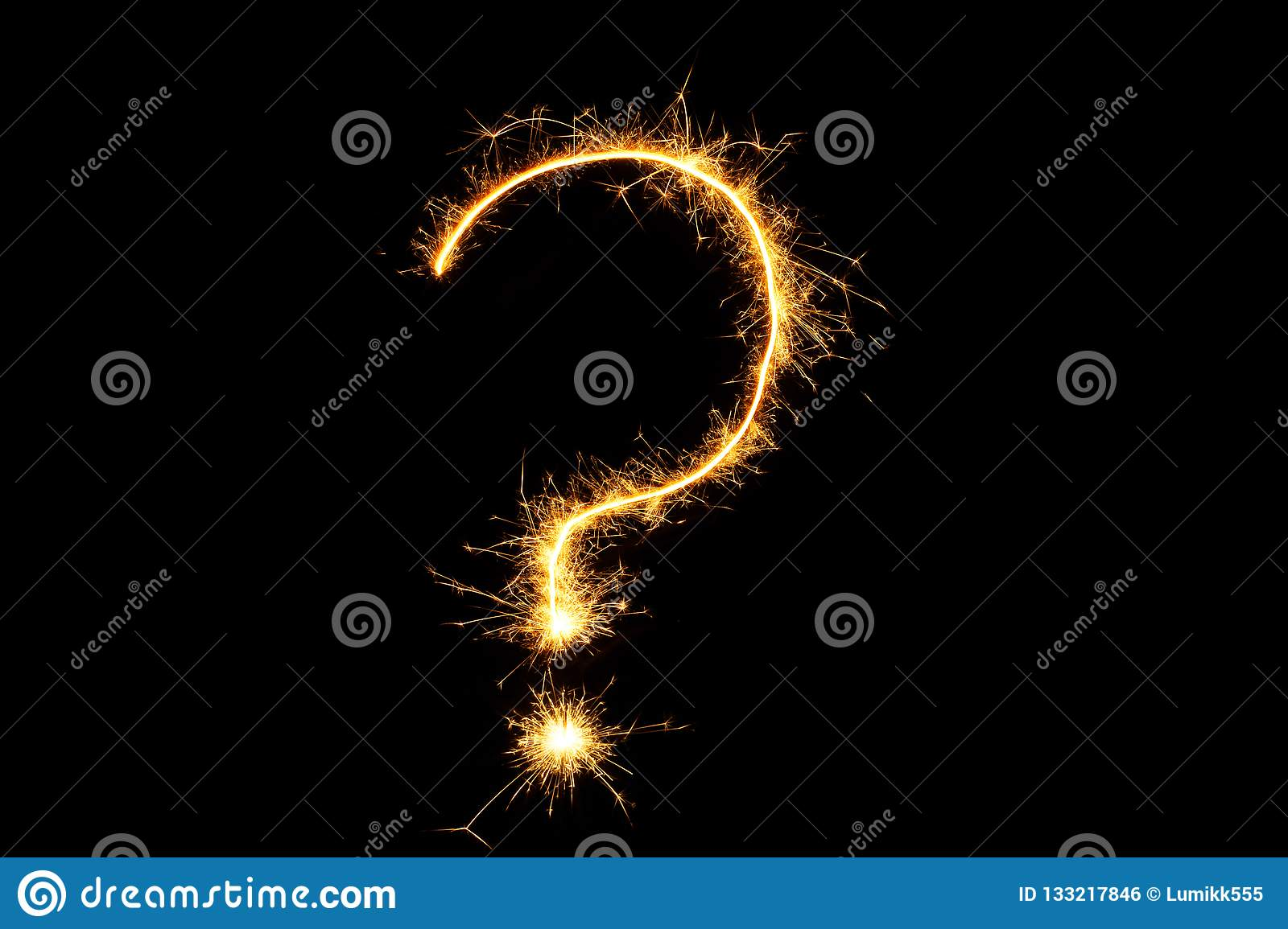 Burning sparkler question mark isolated on black background