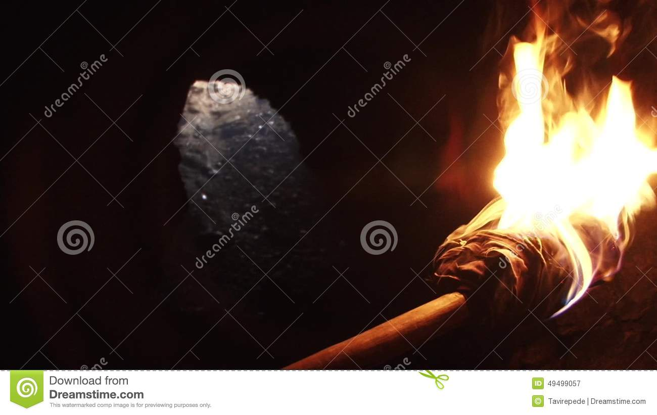 Burning Torch in a Cave stock video. Image of flaming - 49499057 for Burning Wooden Torch  192sfw