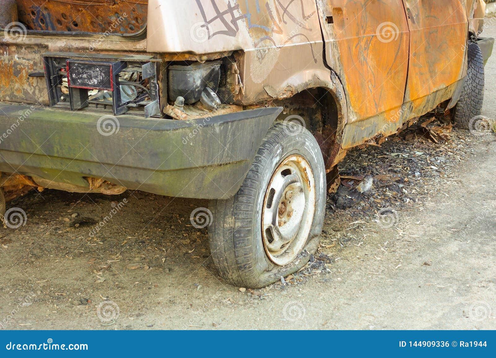 Burnt, abandoned passenger car close-up. Russia
