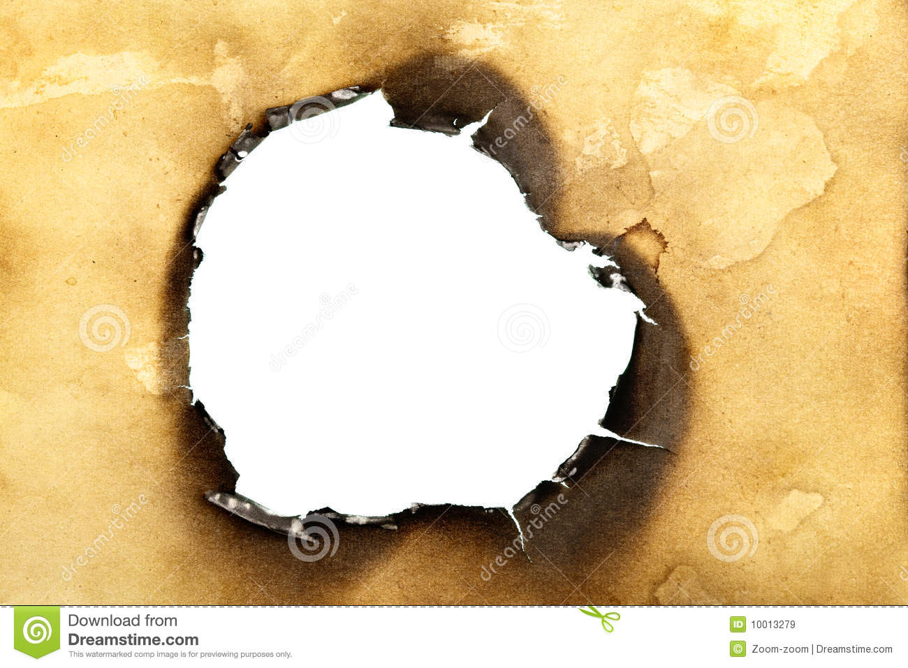 Close up of hole burnt through old yellow paper   stock photo