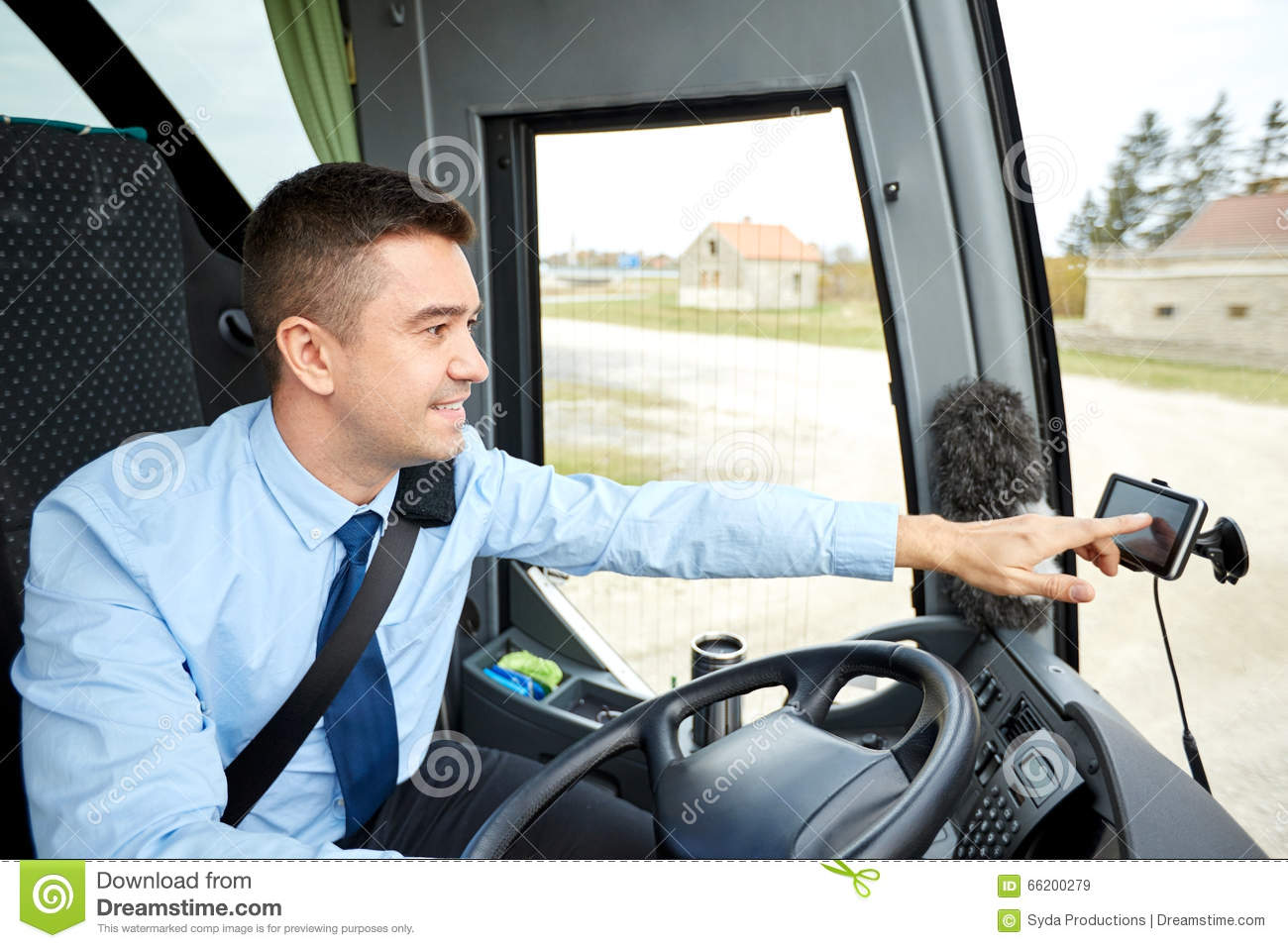 Bus driver entering address to gps navigator