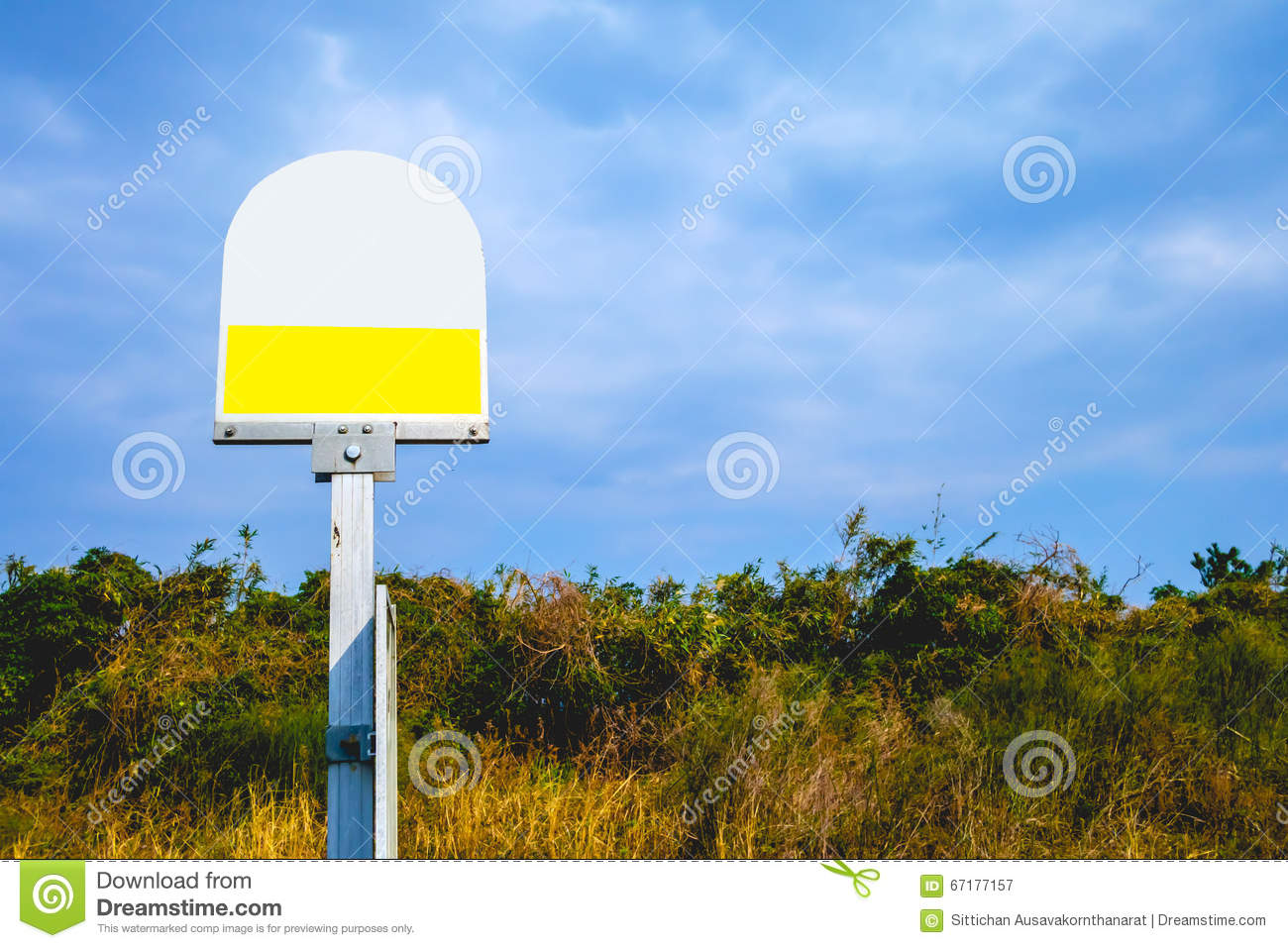 Bus stop sign in the blue sky