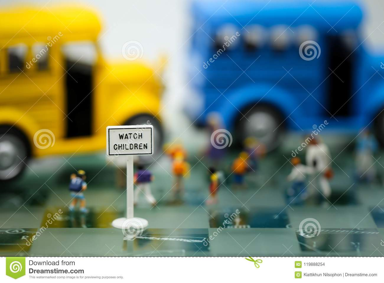 Bus Stop Signs With Blur Of Teacher And A Group Of Elementary Sc