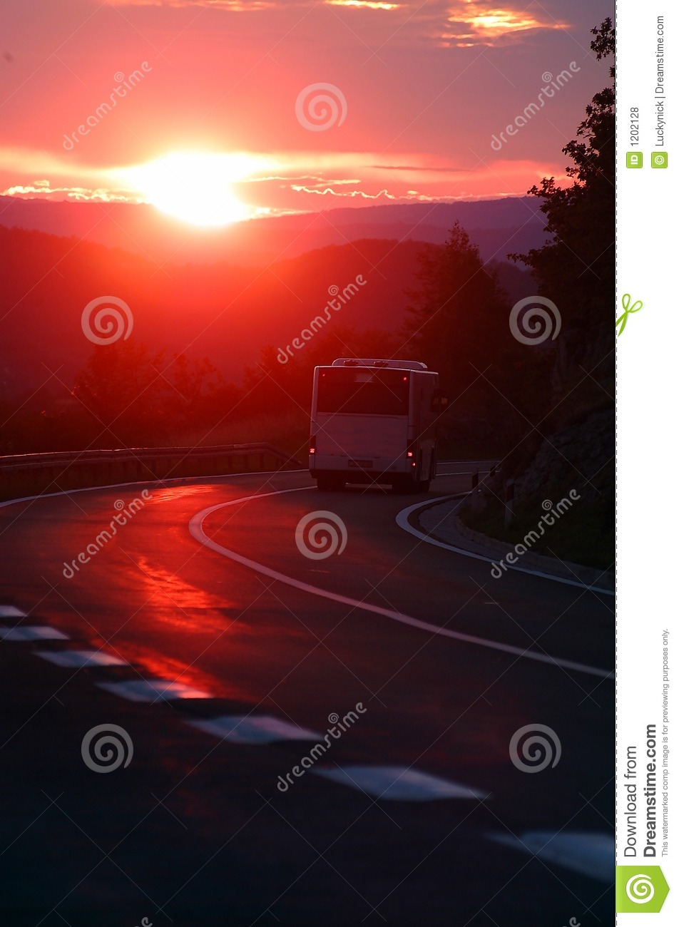 Bus in sunset