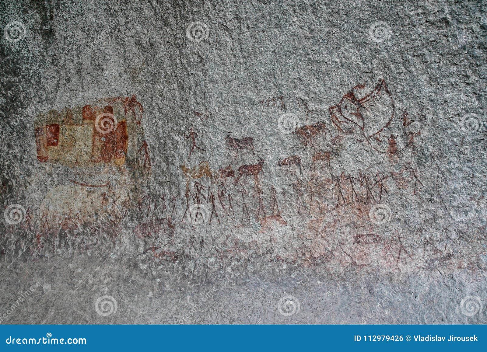 Bushmen rock painting of human figures and antelopes, giraffe of the Matopos National Park, Zimbabwe