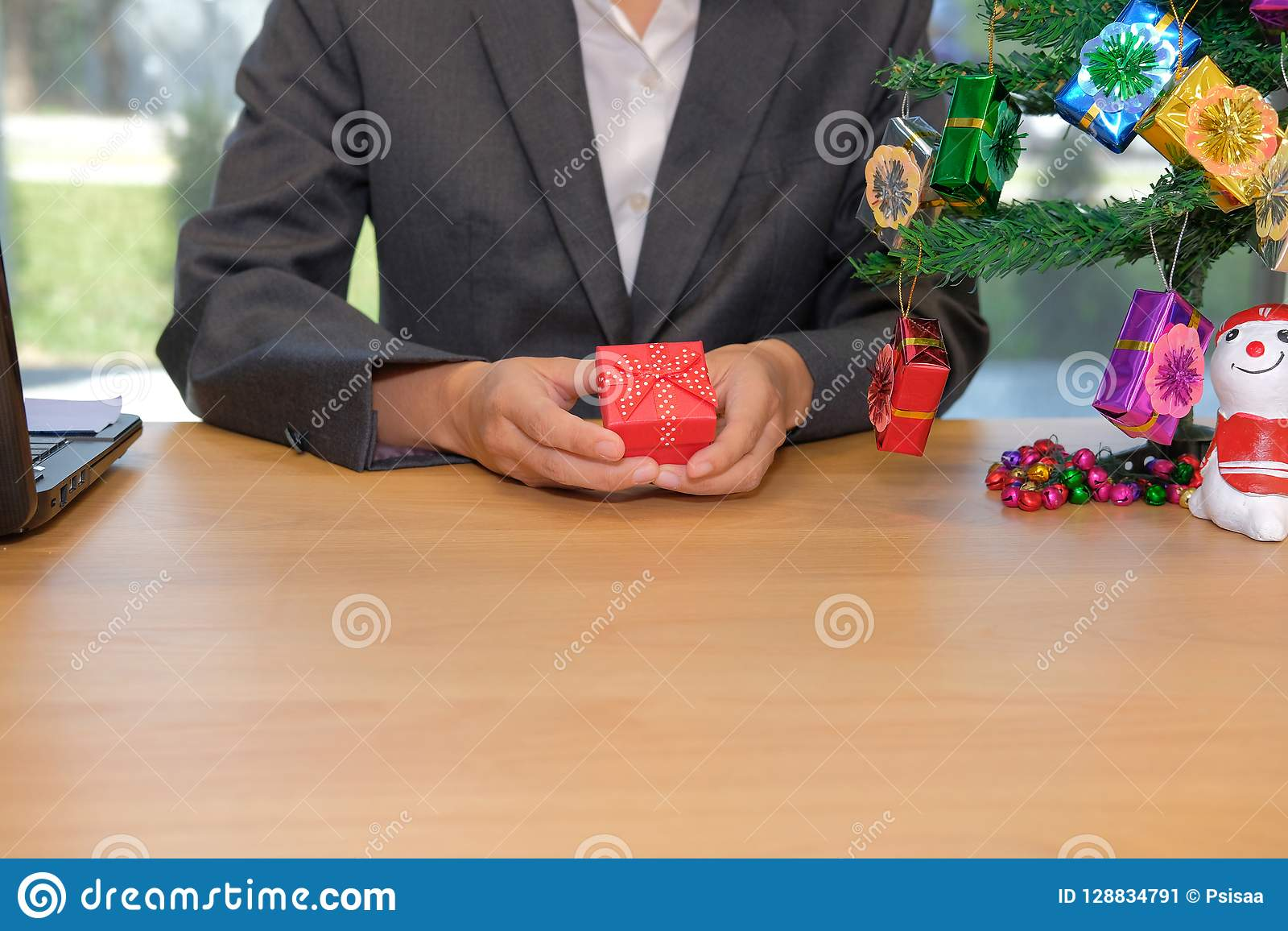businesman holding christmas new year gift box at workplace stock