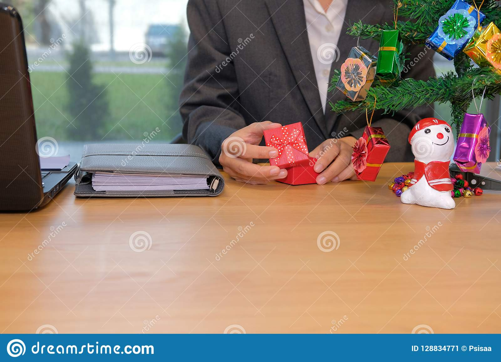 businesman opening christmas new year gift box at workplace stock